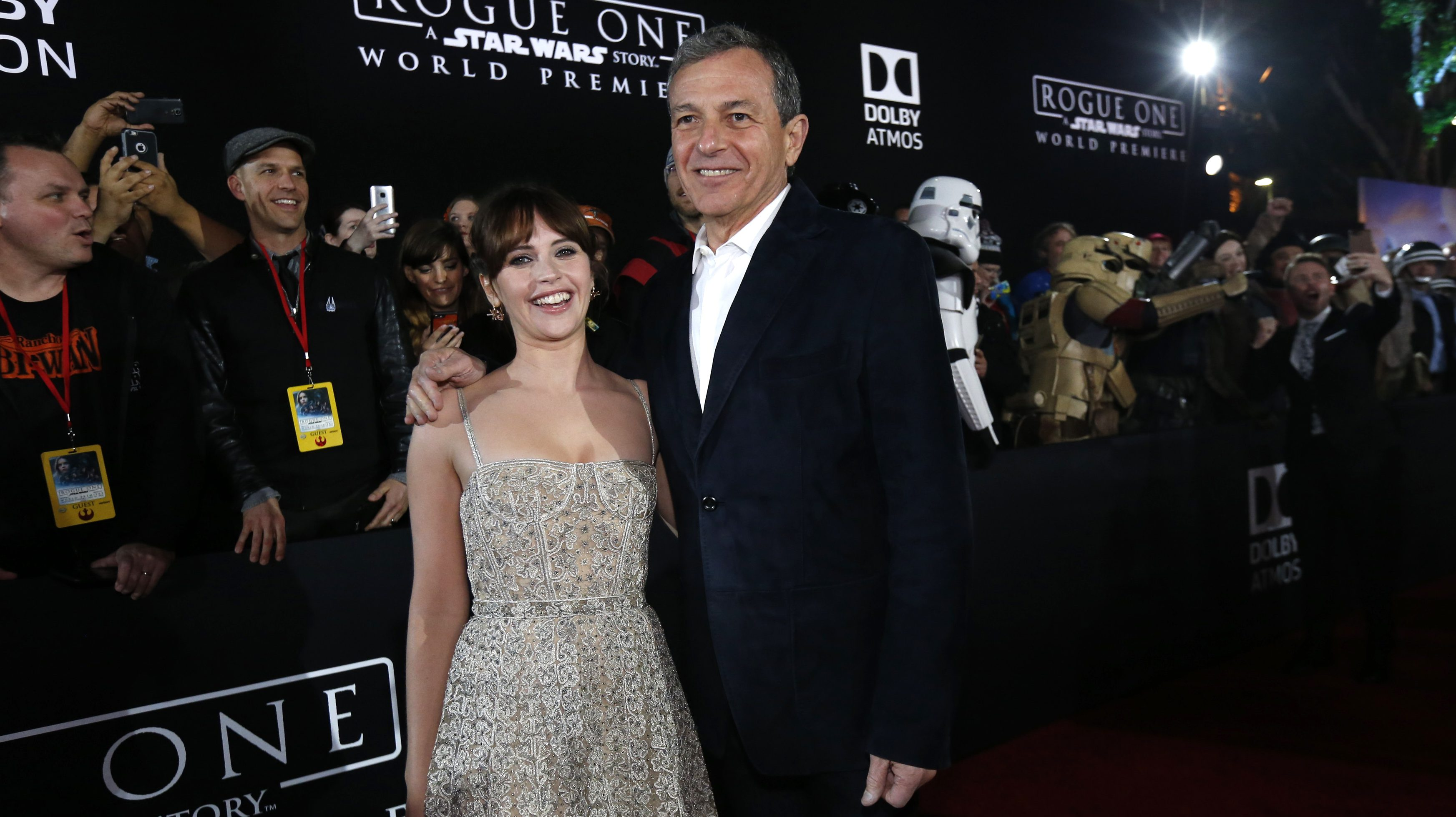 """Actress Felicity Jones and Chief Executive Officer of Disney Bob Iger arrive at the world premiere of the film """"Rogue One: A Star Wars Story"""" in Hollywood, California, U.S., December 10, 2016.  REUTERS/Mario Anzuoni - RTX2UGU3"""