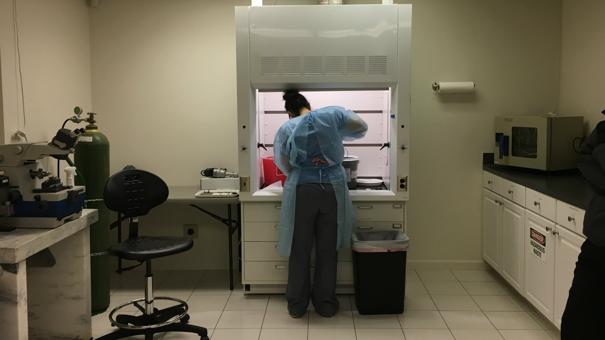 Lab technician Laura Jackson removes a brain from a donor head at the Salem, Ore. offices of Oregon Cryonics.