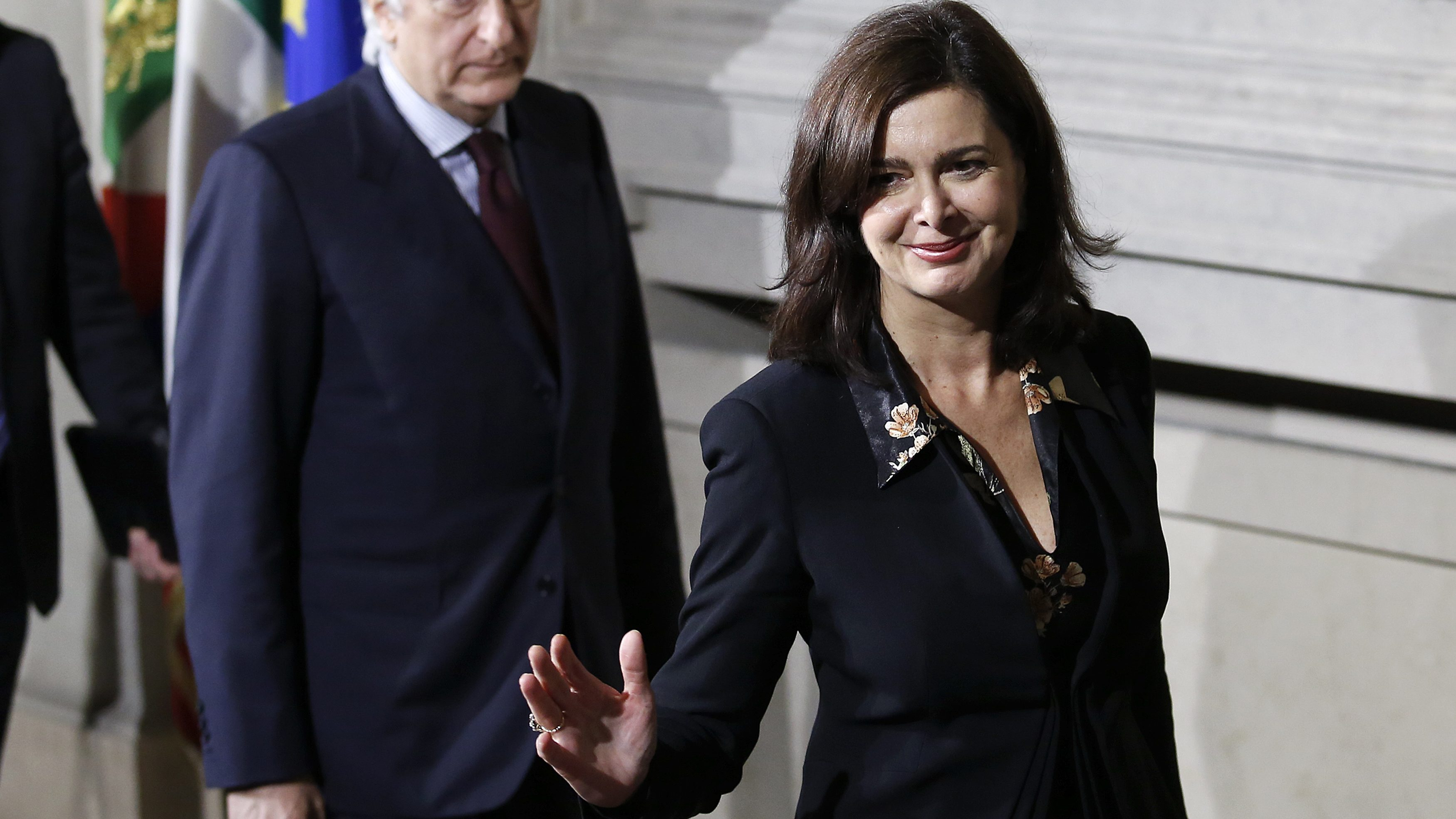 Italy's lower house President Laura Boldrini smiles at the end of the first day of consultations with Italian President Giorgio Napolitano at the Quirinale Palace in Rome February 14, 2014. Italian centre-left leader Matteo Renzi is one step away from forming a new government after he swiftly eliminated party rival Enrico Letta as prime minister. New numbers showing how slowly the economy is growing highlight the huge challenge ahead. After Renzi and the rest of the centre-left Democratic Party (PD) leadership forced Letta's hand by withdrawing their support at a special meeting on Thursday, the prime minister handed his resignation to President Giorgio Napolitano.