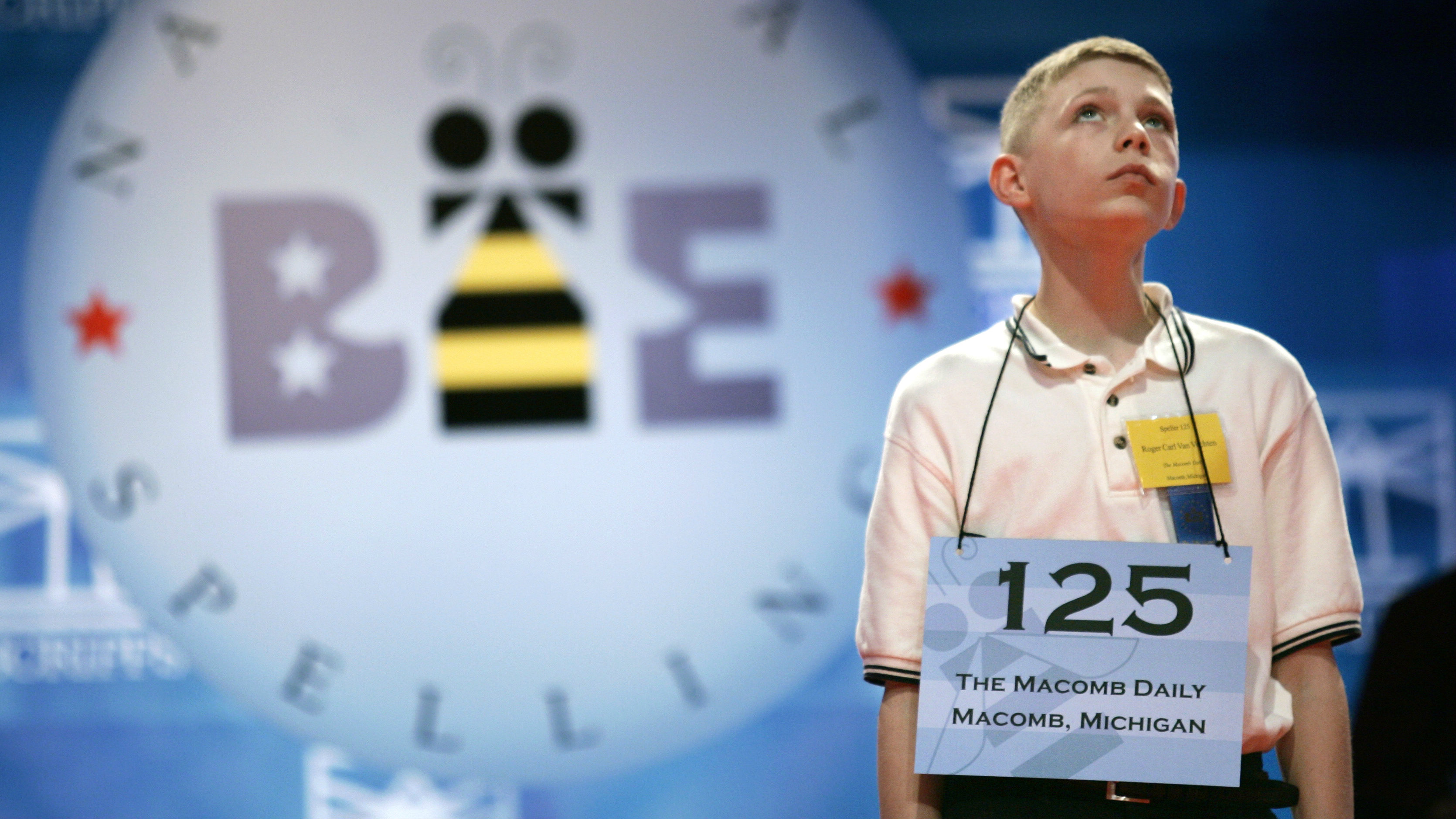 Roger Van Vechten, 14, of Macomb Michigan, looks up as he takes his turn during the National Spelling Bee in Washington May 31, 2006. The finals on June 1 will be broadcast live on prime-time network television for the first time. REUTERS/Kevin Lamarque