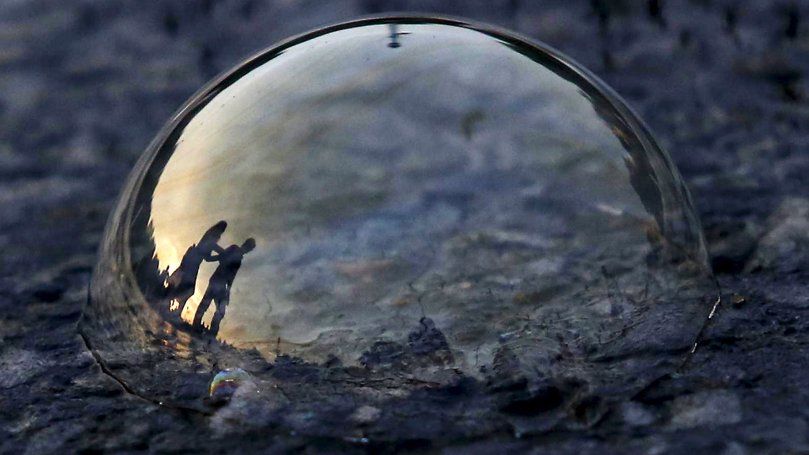A soap bubble on a road in New Delhi.