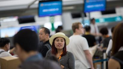 Passengers line up to check-in at Hong Kong International Airport in Hong Kong, China, 11 October 2016. In September the Airport Authority secured a 50-year land lease to develop retail, dining and entertainment hub. EPA/JEROME FAVRE
