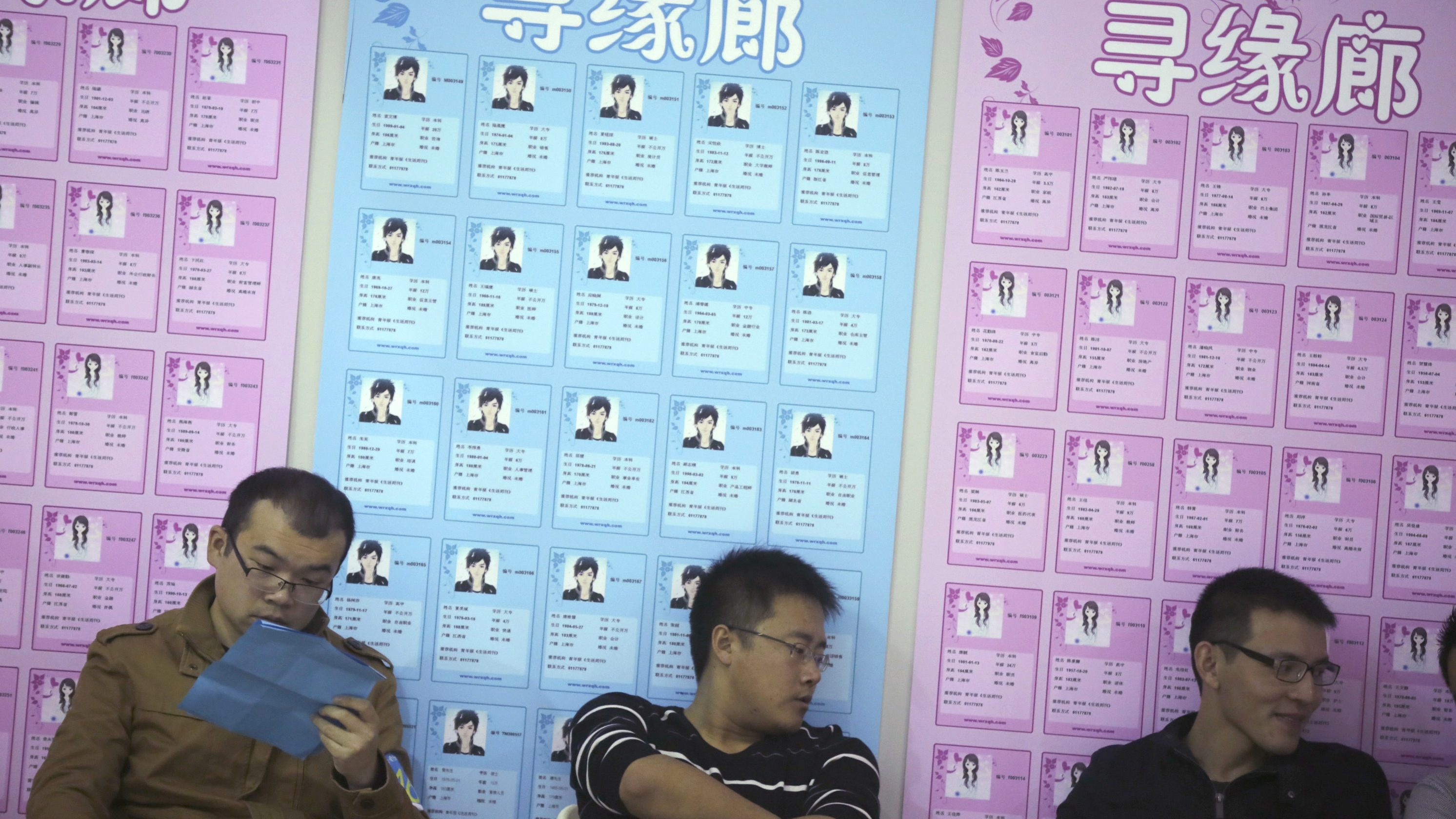 """Male participants take part of a bachelor's meeting event during a mass match-making event ahead of Singles Day in Shanghai, China, Saturday, Nov. 9, 2013. Singles Day was begun by Chinese college students in the 1990s as a version of Valentine's Day for people without romantic partners. The timing was based on the date Nov. 11, or """"11.11"""" — four singles. (AP Photo/Eugene Hoshiko)"""