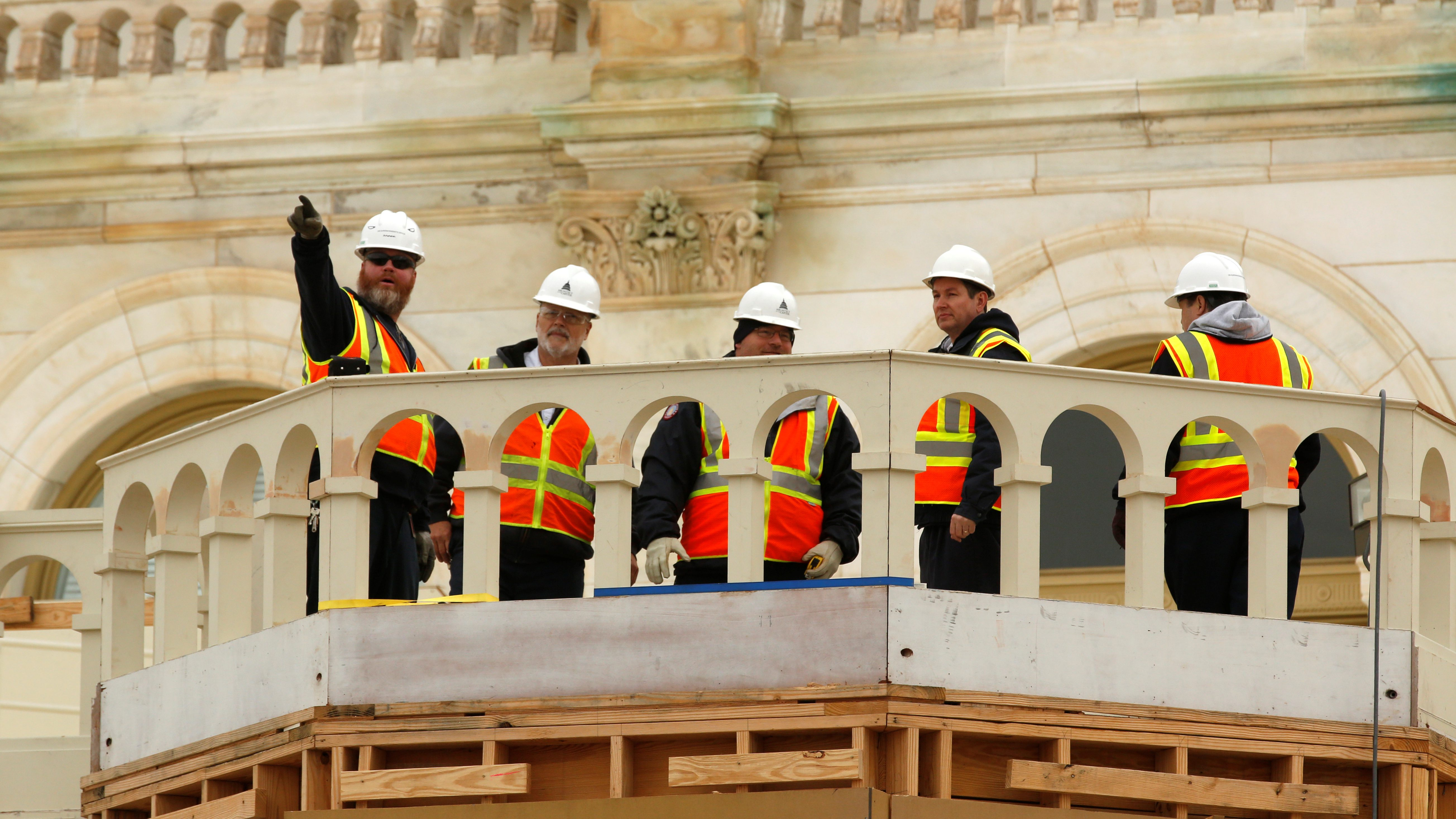 Workers construct the stands where U.S. President-elect Donald Trump wil take the oath of office during his January inauguration at the U.S. Capitol in Washington, U.S., December 8, 2016.  REUTERS/Jonathan Ernst - RTSVA7T