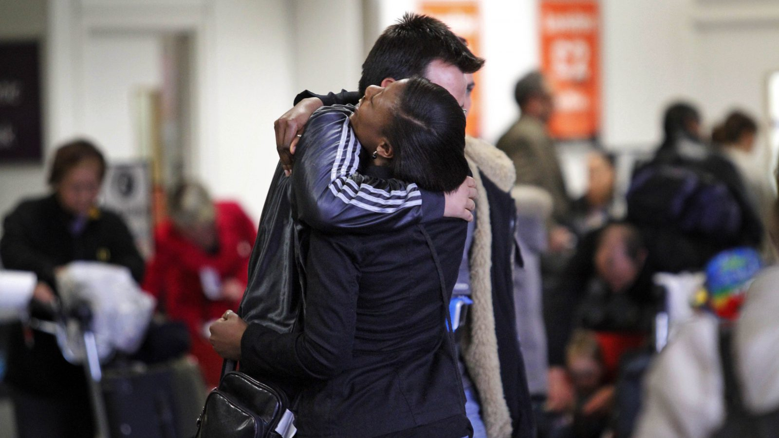 A couple embrace each other after they were re-united at the arrival hall of Gatwick airport, near London, England, Wednesday, April 21, 2010. Britain's Heathrow Airport _ Europe's busiest hub _ has seen the first flight land in London since airspace across the continent was closed by the giant plume of ash spewed during a volcanic eruption in Iceland.(AP Photo/Lefteris Pitarakis)