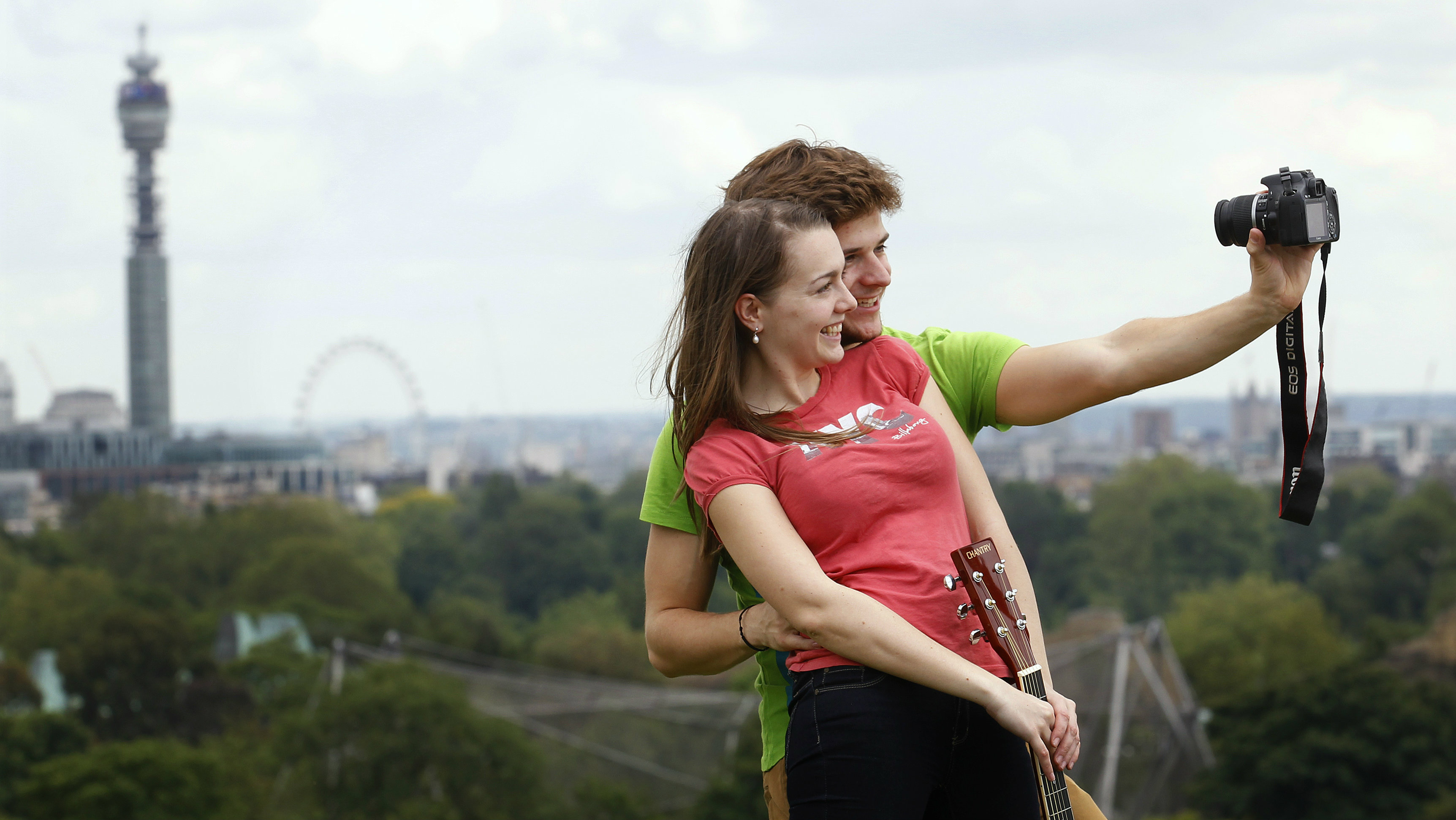Mardi MacGregor from London poses with her boyfriend Bastian Guhl from Berlin, on Primrose Hill in London June 19, 2012. REUTERS/Suzanne Plunkett (BRITAIN - Tags: SOCIETY)