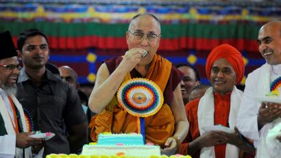 Tibetan spiritual leader, the Dalai Lama eats a piece of a cake to celebrate his birthday at Drepung Loseling Monastery in Mundgod, in the southern state of Karnataka, India,
