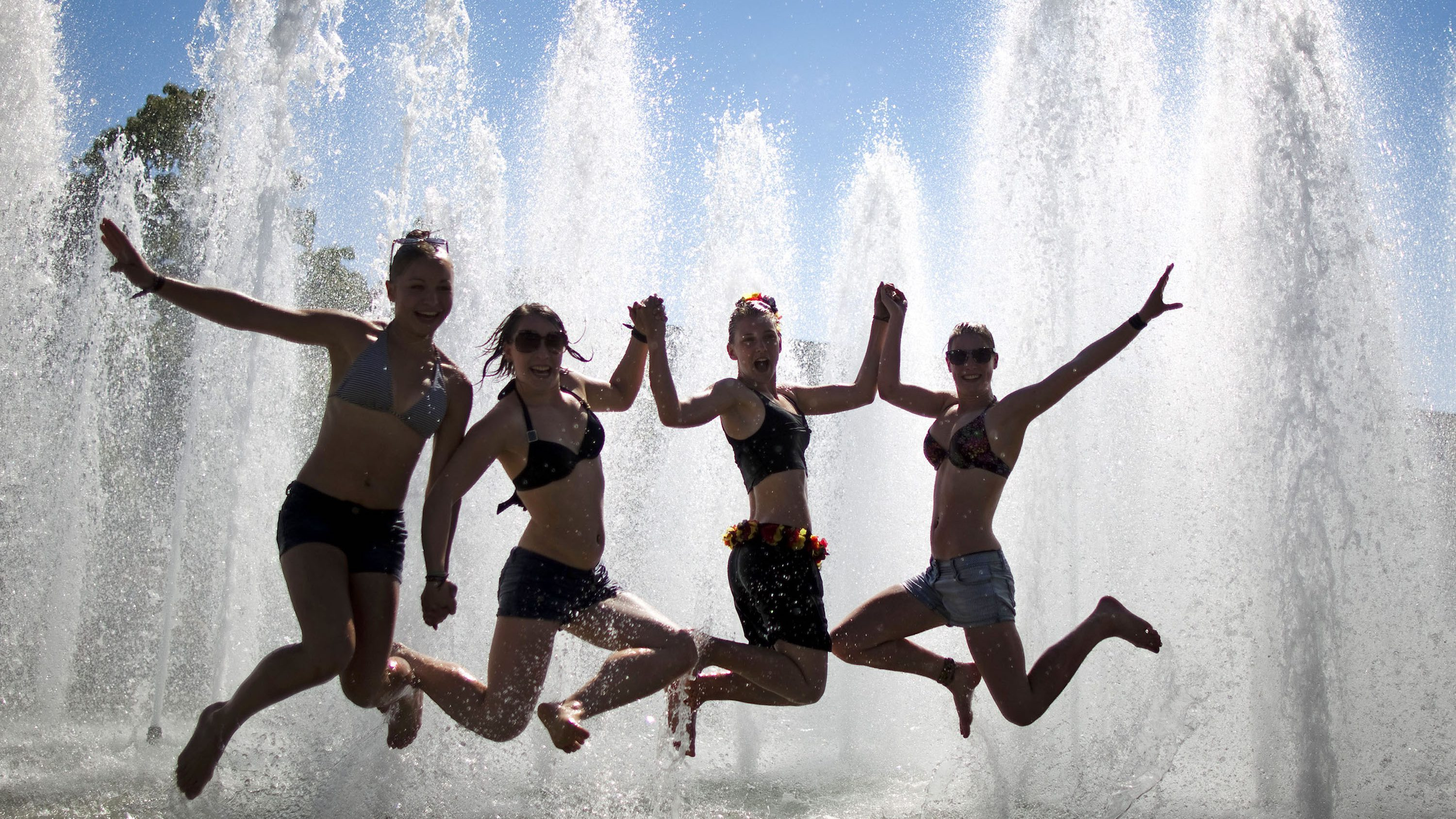 Gymnasts pose for a picture in a fountain on the second day of the 2011 World Gymnaestrada in Lausanne July 11, 2011. More than 20,000 participants from around the world will join in gymnastic performances over the next seven days at the non-competitive event.