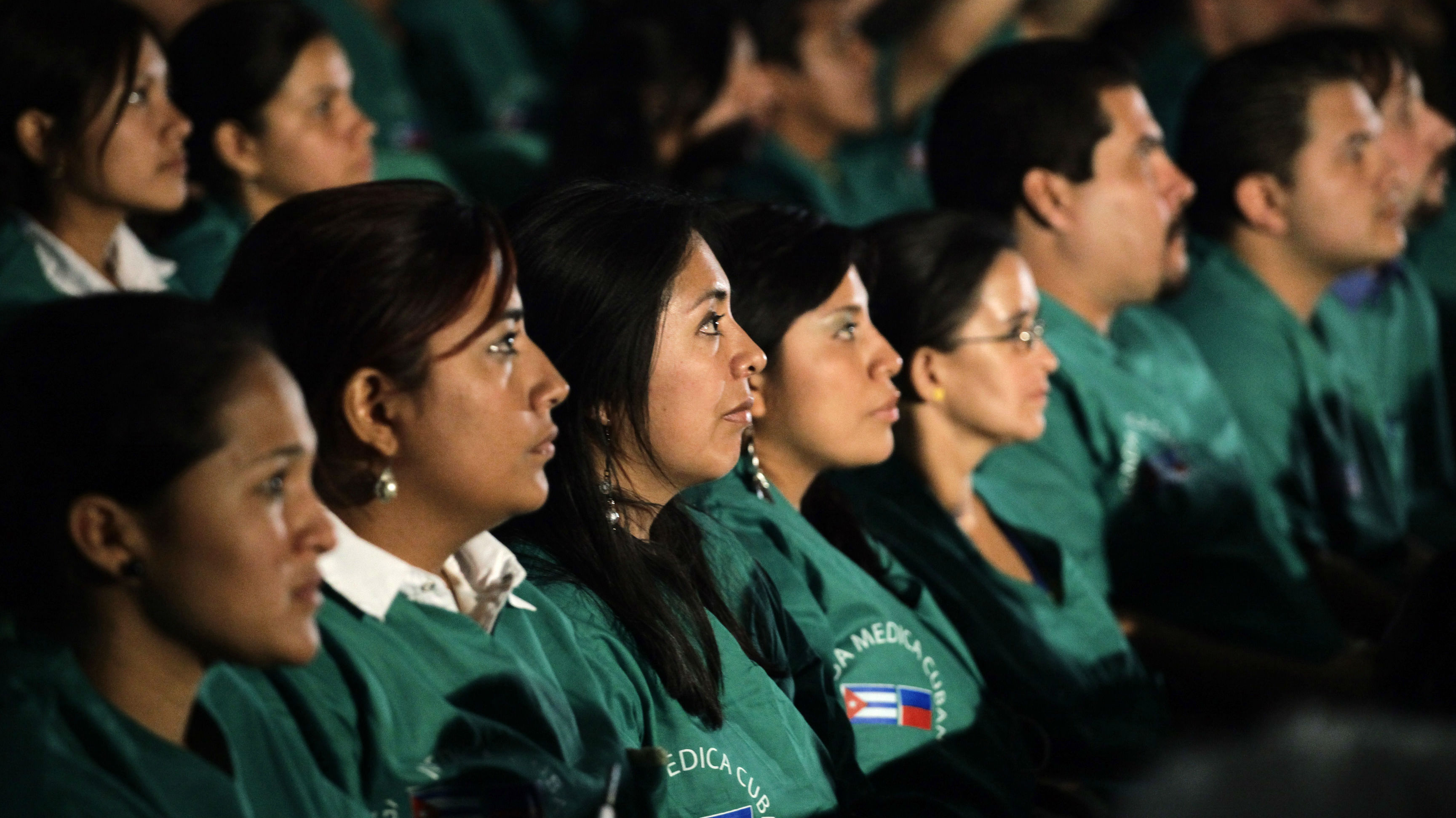 A group of around 200 doctors from 24 countries, who have recently graduated from the Latin American Medical College in Havana, attend a ceremony before leaving on a mission to aid Haiti February 10, 2010.