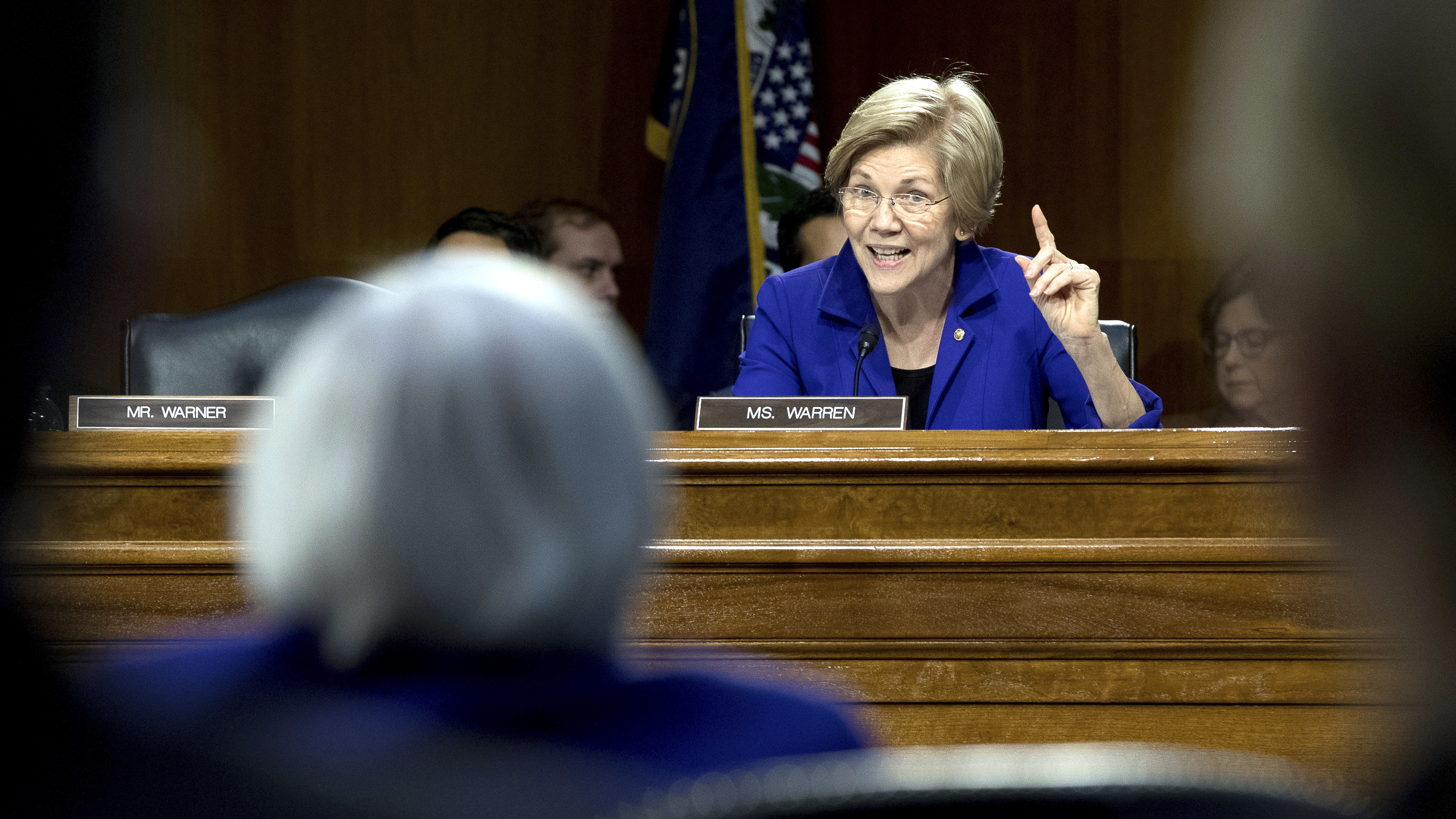 Senate Banking Committee member Sen. Elizabeth Warren, D-Mass., right, questions Federal Reserve Chair Janet Yellen on Capitol Hill in Washington, Tuesday, Feb. 14, 2017, during the committee's hearing. Yellen said that the central bank still expects to raise interest rates gradually this year. But she said the Fed also recognizes the dangers of waiting too long to tighten credit.