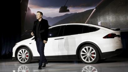 Tesla Motors CEO Elon Musk delivers Model X electric sports-utility vehicles during a presentation in Fremont