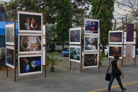 Some of Brother Jun's photos of extra-judicial killings are included in this roving exhibit in the parking lot of a parish in Manila.