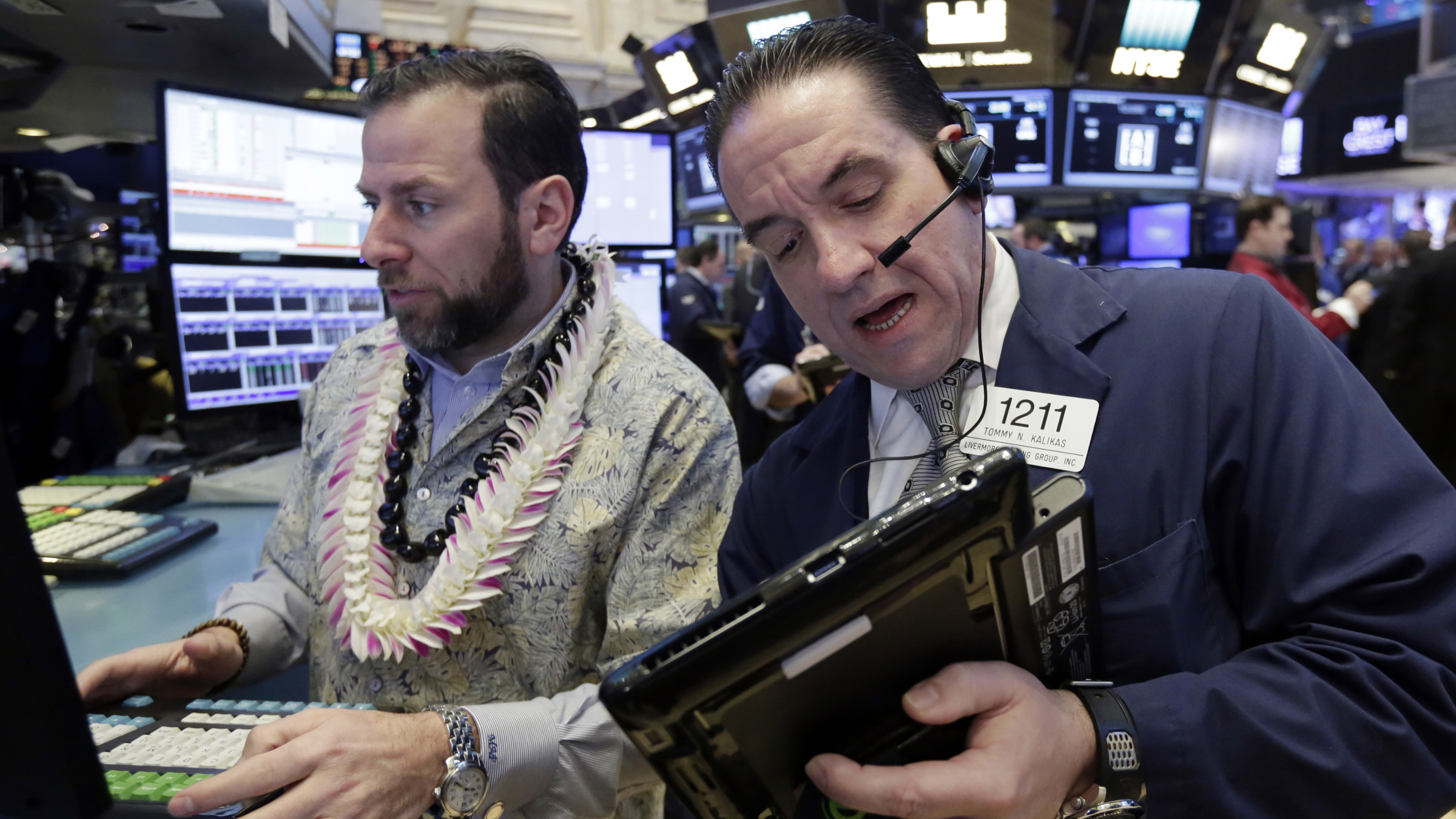 Specialist Michael Pistillo, left, and trader Tommy Kalikas work on the floor of the New York Stock Exchange, Tuesday, Jan. 10, 2017. The stock market is getting off to a mixed start as drops in real estate and utilities offset gains in other sectors including health care.