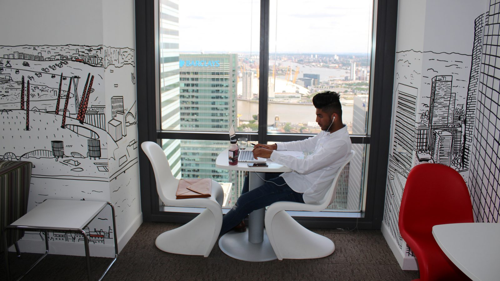 A man uses a laptop in the Level39 FinTech hub based in the One Canada Square tower of the Canary Wharf district of London, Britain, August 5, 2016. Picture taken August 5, 2016. REUTERS/Jemima Kelly - RTSLRCT