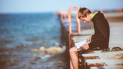 guy reading on dock