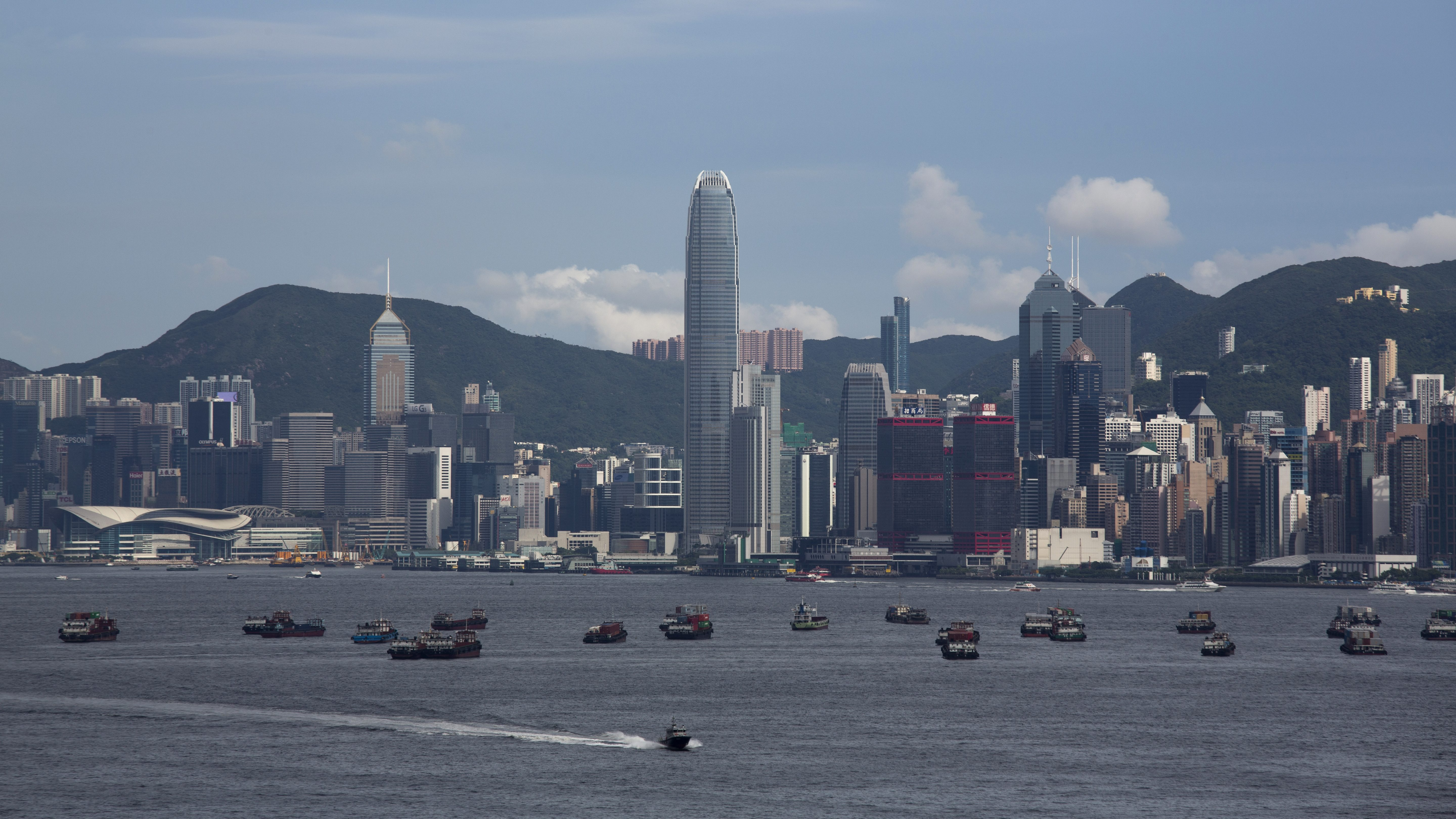 Boats lie at anchor in front of residential and commercial high-rise buildings on Hong Kong island, in Hong Kong, China, 07 August 2014. Consultancy firm New World Wealth claimed that Hong Kong has 15,400 multimillionaires, those with at least US10 million US dollars in net assets, more than any other city in the world. The consultancy said New York came second and London third with 14,300 and 9,700 multimillionaires respectively. Those Hong Kong wealthy and super wealthy residents hold net assets totalling a minimum of some 350 billion US dollars.