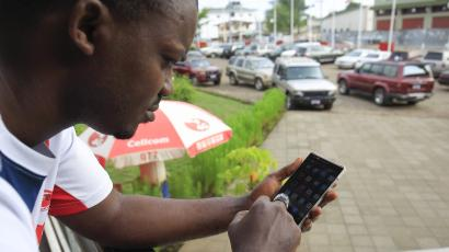 A man using a cellphone in Monrovia, Liberia 15 April 2016.