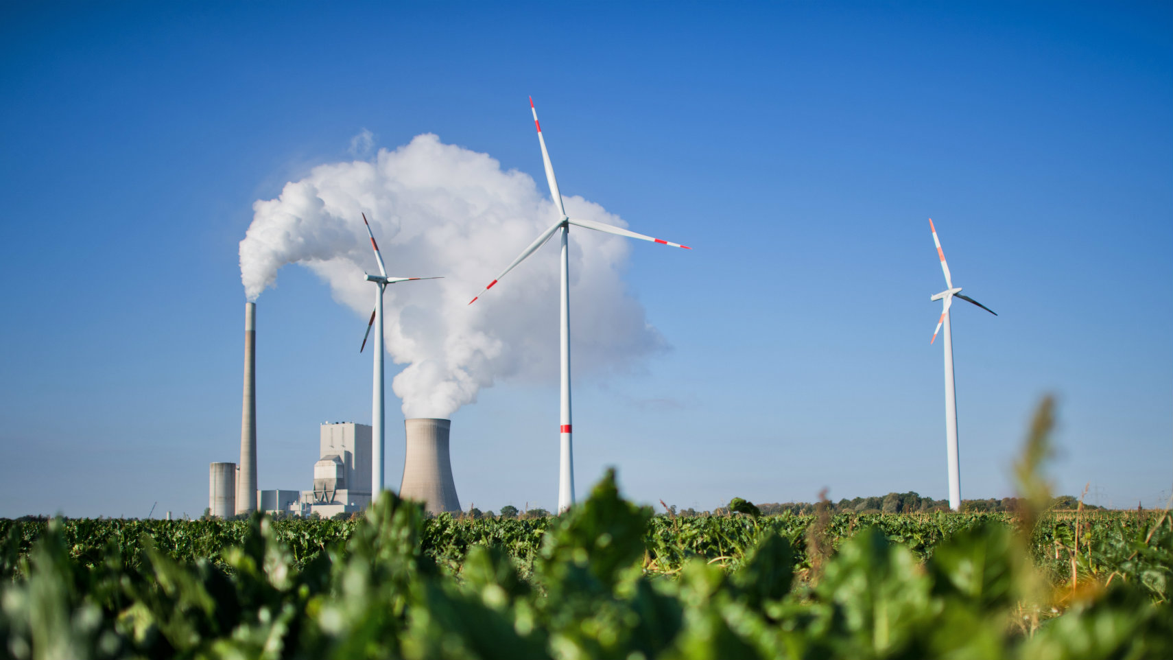 The coal power plant Mehrum and wind turbines producing energy in Hohenhameln, Germany