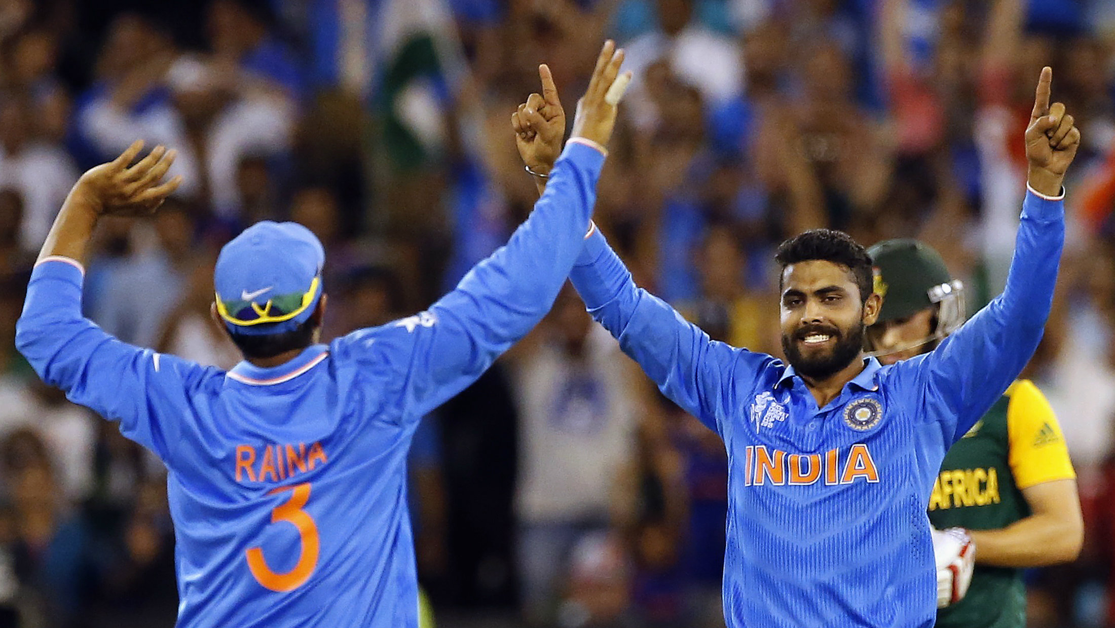 South Africa's Parnell reacts as India's Jadeja and Raina celebrate winning their Cricket World Cup match.