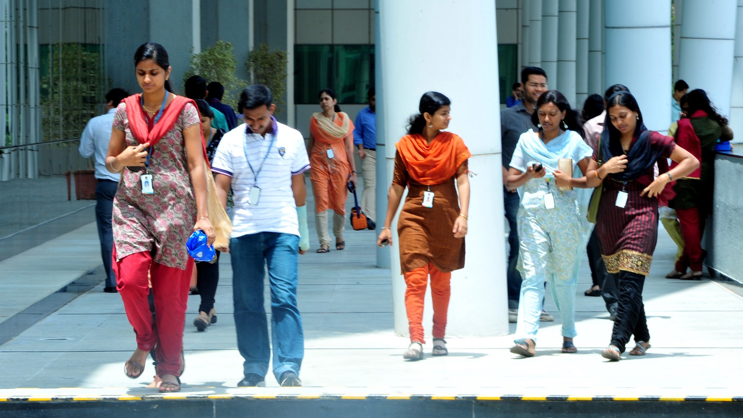 epa03316011 Indian software employees of Wipro seen at Wipro campus in southern Indian city of Bangalore, 24 July 2012. Wipro Ltd, India's No. 3 software services exporter, reported an 18 per cent rise in quarterly net profit, meeting expectations, as customers outsourced more work to the company to cut their operational expenses.  EPA/JAGADEESH NV