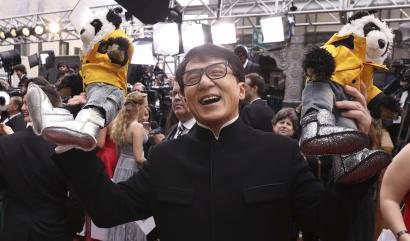 Jackie Chan arrives at the Oscars on Sunday, Feb. 26, 2017, at the Dolby Theatre in Los Angeles. (Photo by Matt Sayles/Invision/AP)