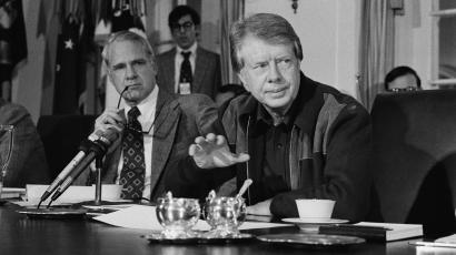 President Jimmy Carter discusses problems dealing with the energy shortage during a special meeting of his Cabinet, Jan. 29, 1977 in the White House. Behind the president is James Schlesinger, his advisor on energy. (AP Photo/John Duricka)