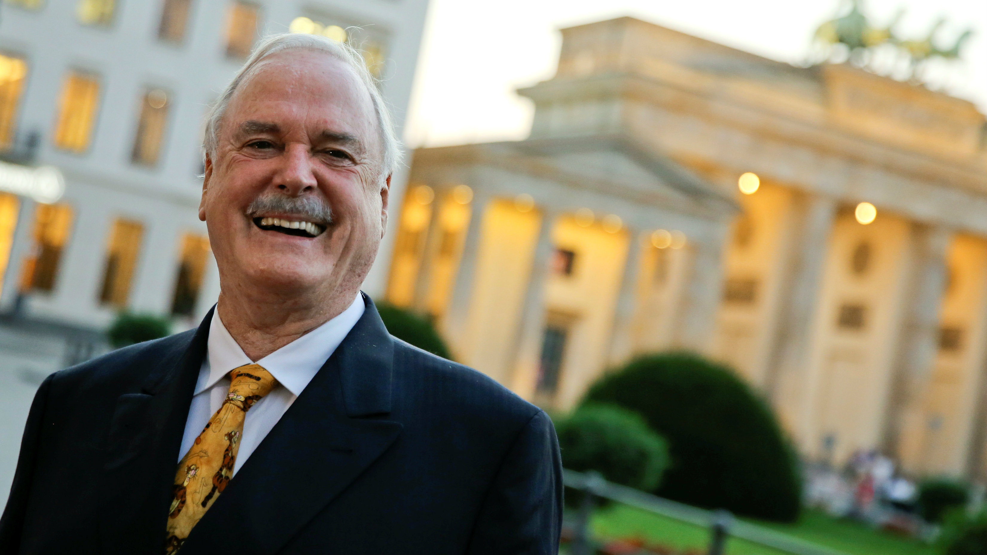 British actor John Cleese poses in front of the Brandenburg Gate ahead of the Rose d'Or award ceremony where he will be awarded for his lifetime achievement in Berlin, Germany, September 13, 2016. REUTERS/Fabrizio Bensch