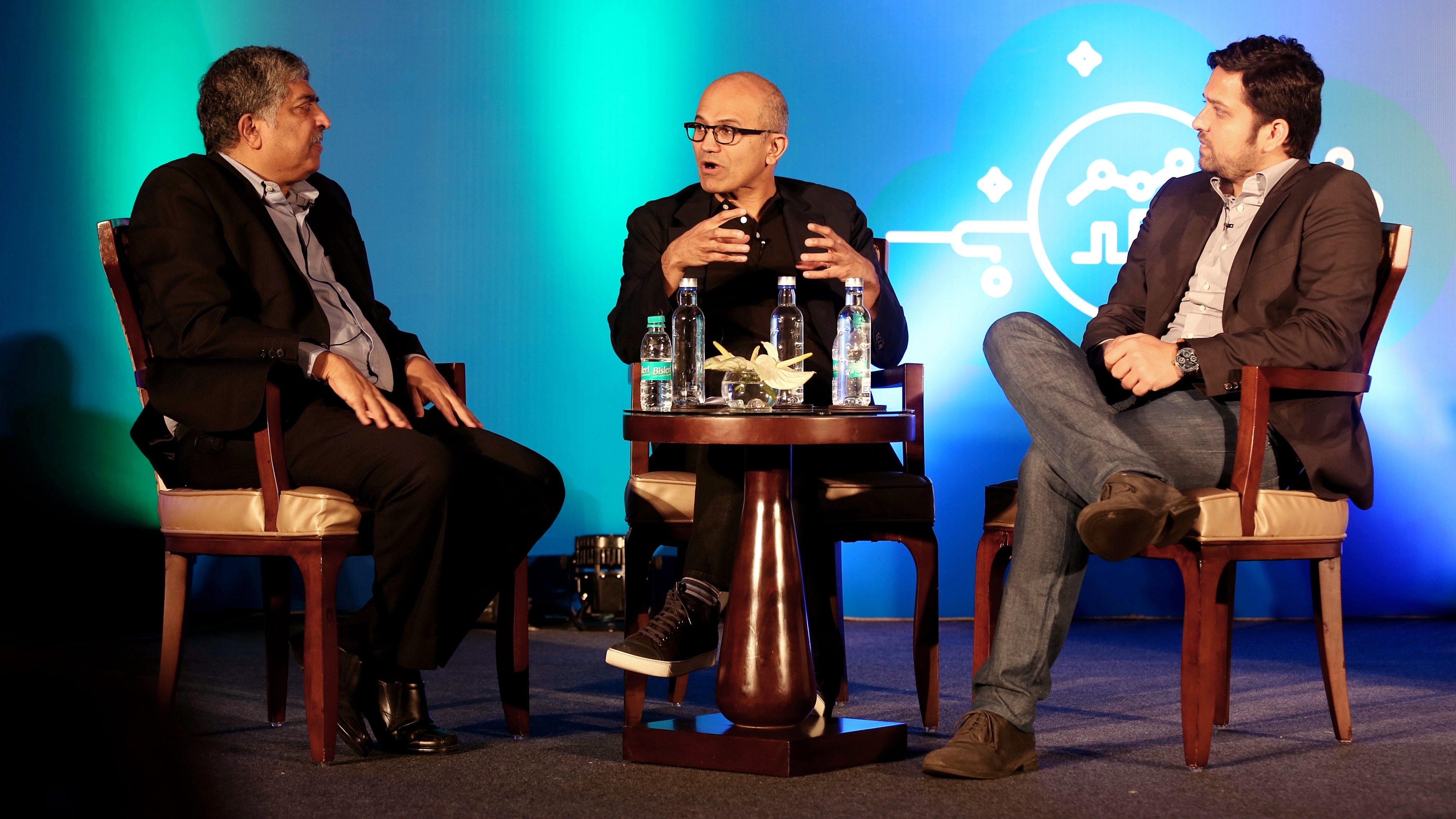 Co-founder of Infosys Technologies Nandan Nilekani (L), Microsoft Chief Executive Officer Satya Nadella (C) and Group Chief Executive Officer and Co-Founder of Flipkart Binny Bansal (R) converse during an interactive session on Indian startups use of Microsoft Cloud for artificial intelligence, in Bangalore, India, 20 February 2017.