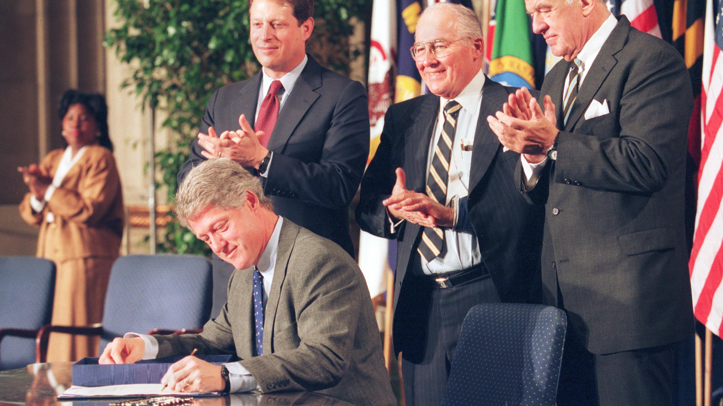 Former US President signing NAFTA.