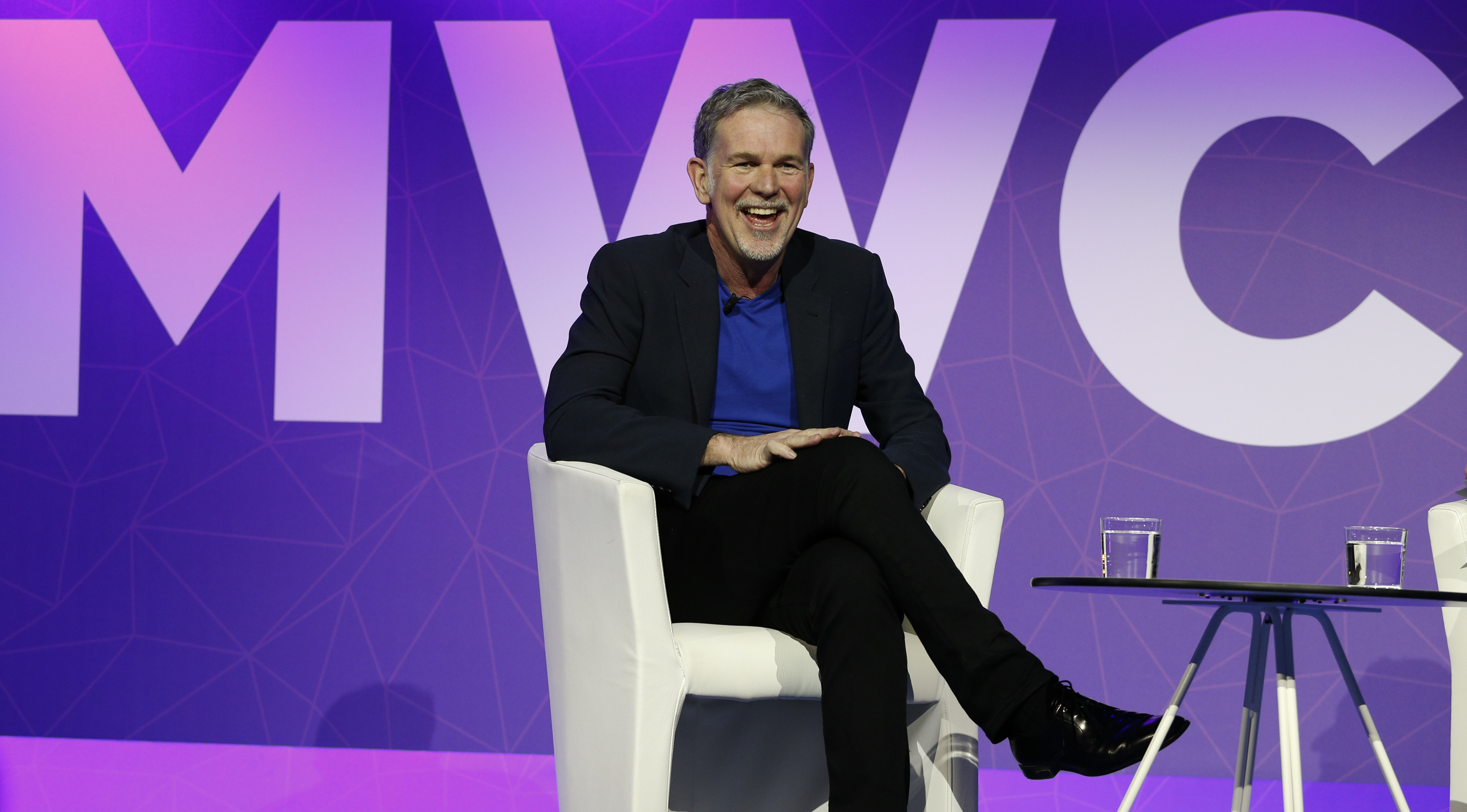 Netflix's CEO Hastings reacts as he delivers his keynote speech during Mobile World Congress in Barcelona
