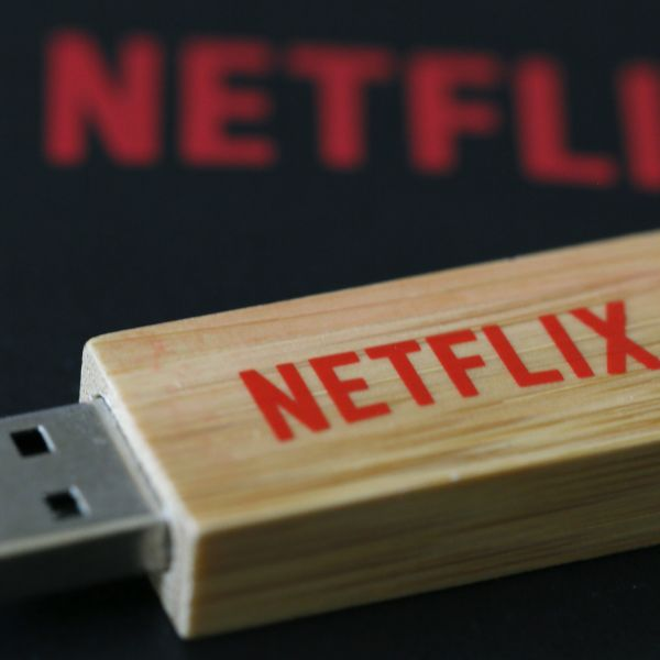 An USB key with the logo of Netflix, the American provider of on-demand Internet streaming media, is seen in this illustration photo, in Paris September 15, 2014.