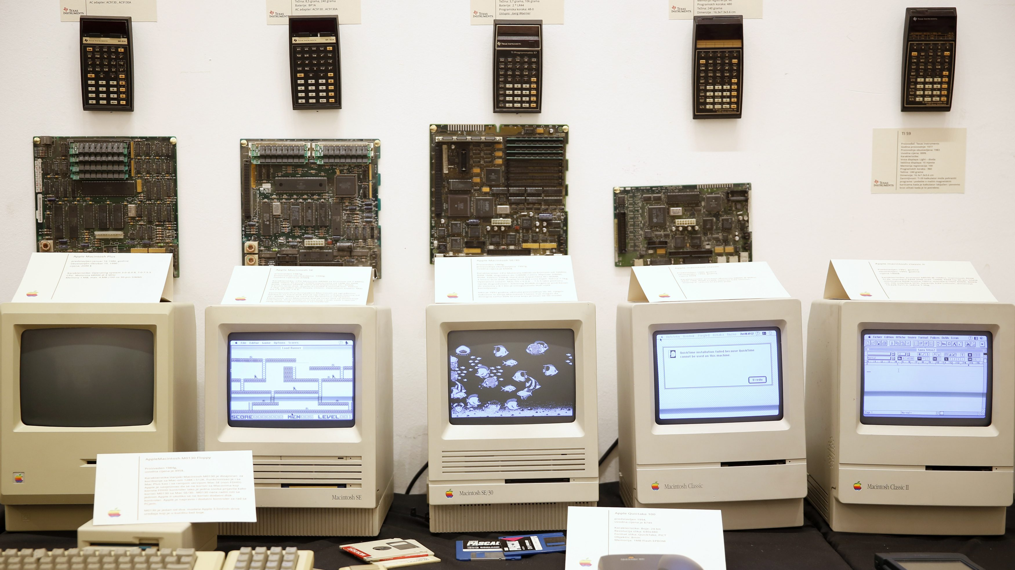 """Apple's Macintosh motherboards and computers together with calculators are displayed during the """"History of Computers"""" exhibition in Sarajevo November 30, 2013. 110 computers from the 1970s to 2008 are displayed during the exhibition, ahead of the opening of the Sarajevo museum of old computers."""