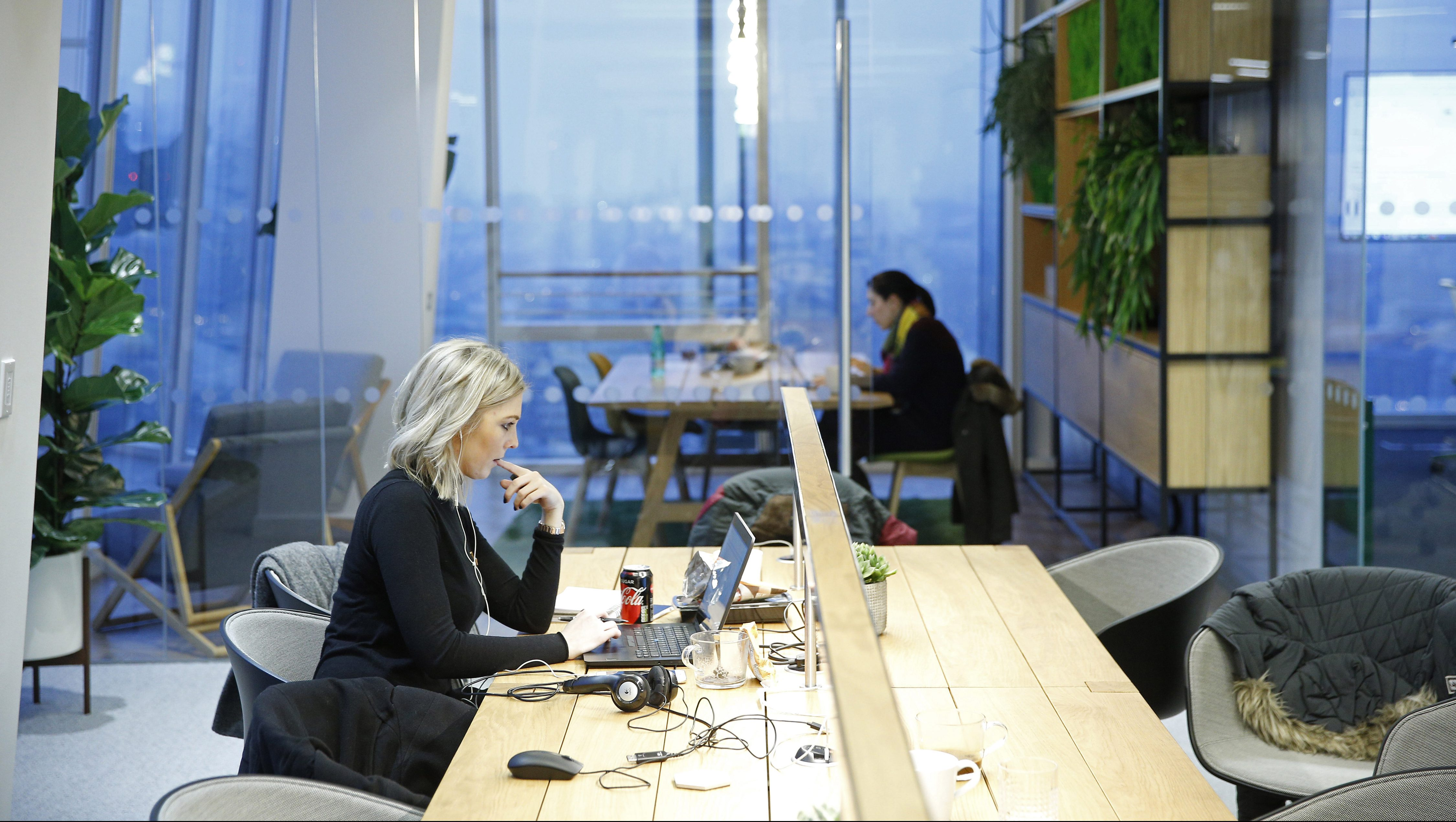 Workers sit at their desks at the Jellyfish office space in London, Britain December 19, 2016.
