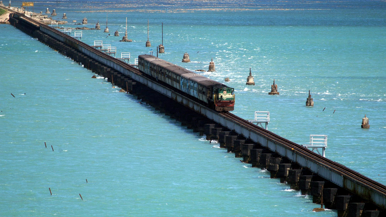 A passenger train passes over a bridge that connects Pamban to the island of Rameshwaram about 635 kilometers (397 miles) south of Madras, India, Thursday, June 22, 2006.