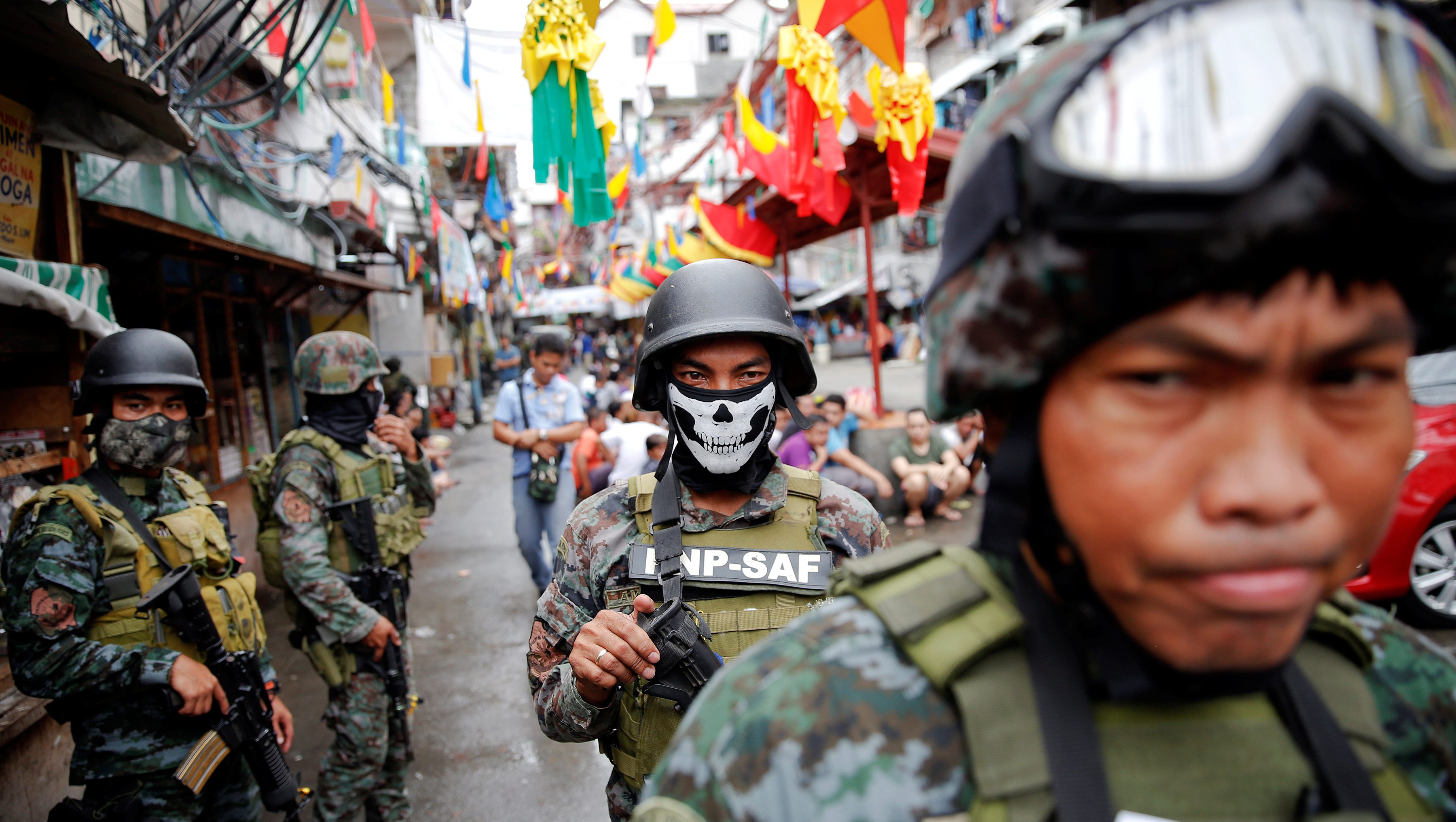 Armed security forces take a part in a drug raid, in Manila, Philippines