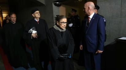 Ruth Bader Ginsburg walks in a hallway after US President Donald Trump's inauguration.