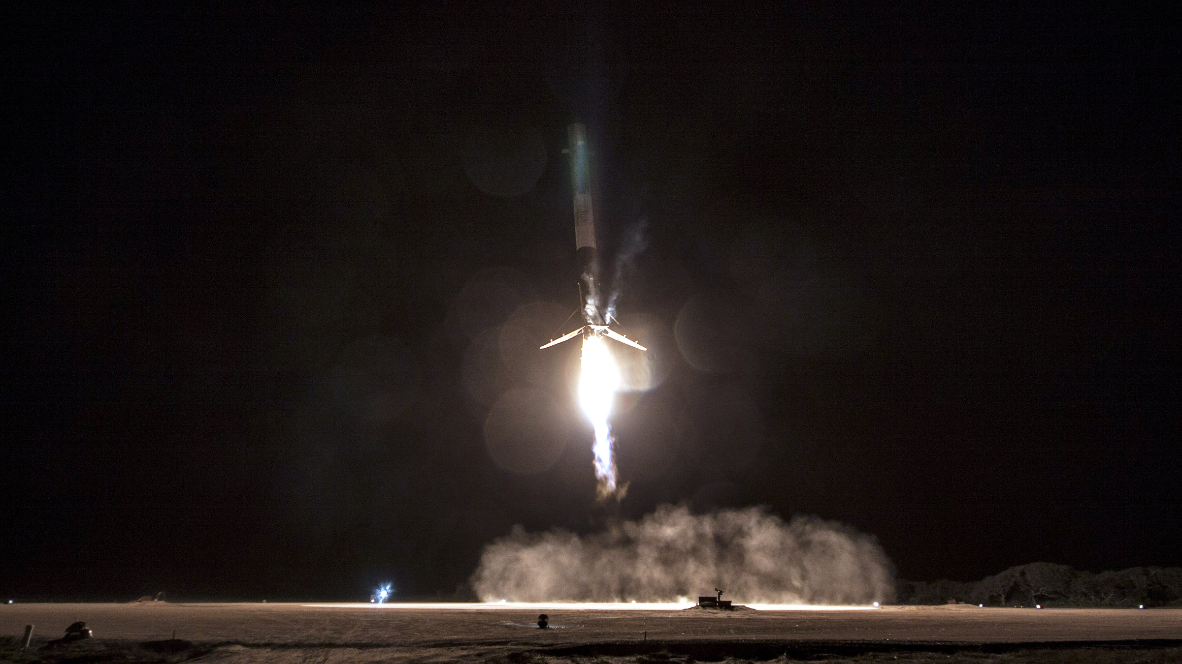 A SpaceX Falcon 9 first stage touches down after flight.