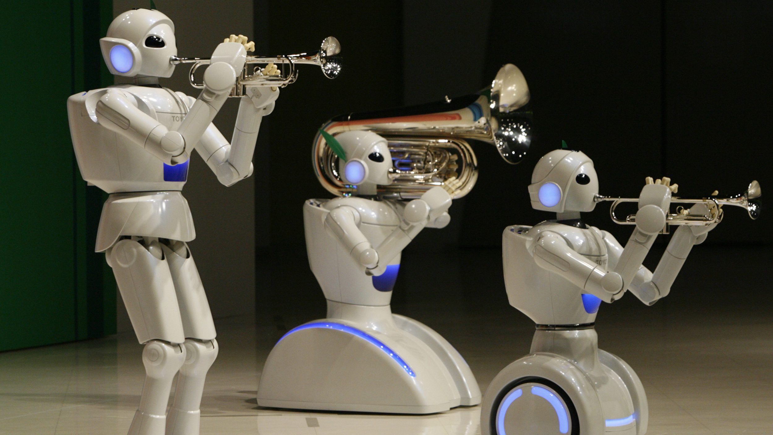 Toyota Motor Corp's partner robots play instruments at the company's showroom in Tokyo May 4, 2008.