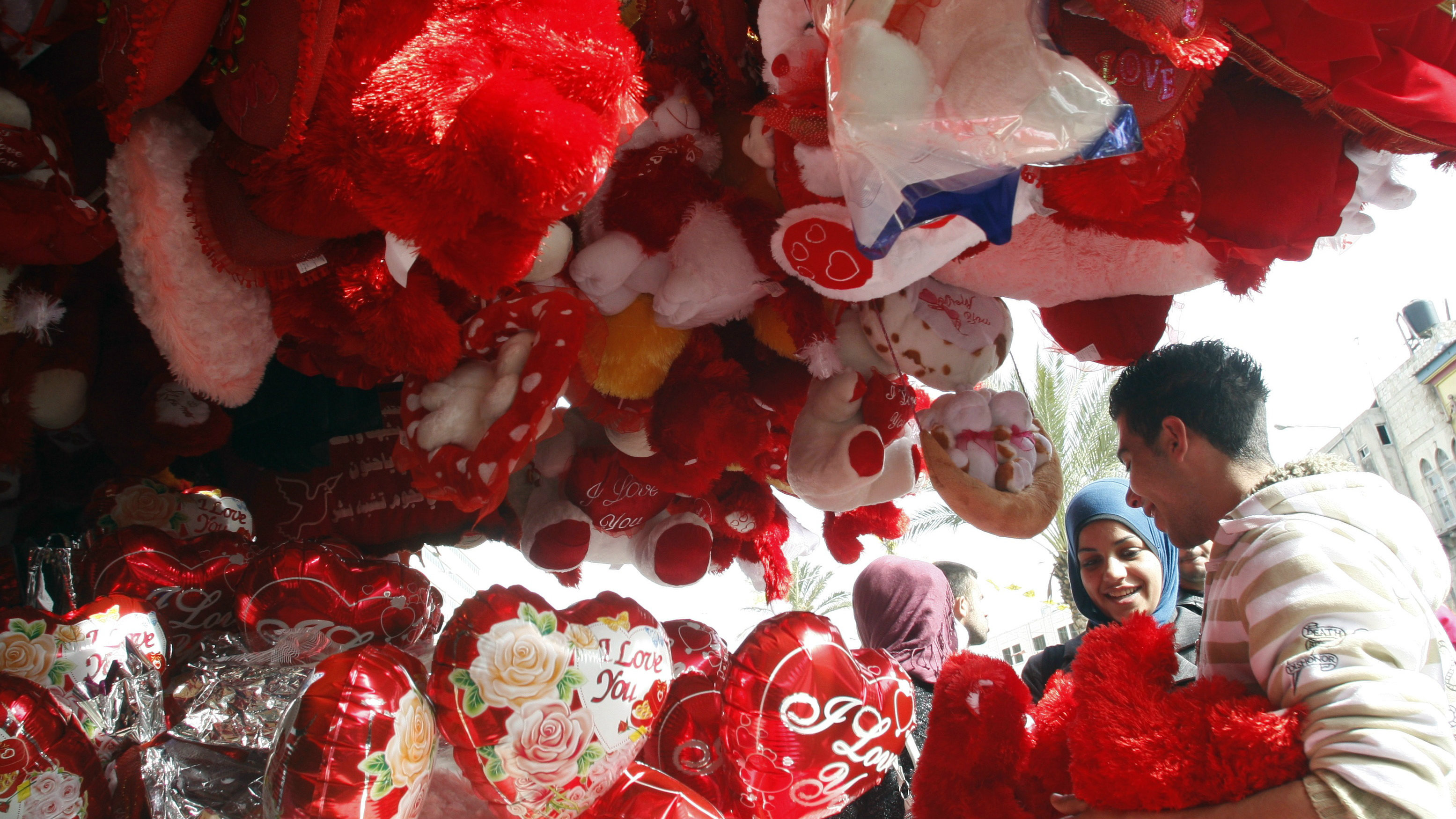 A Palestinian woman looks at Valentine's Day gifts at a shop in the West Bank city of Nablus February 14, 2010.