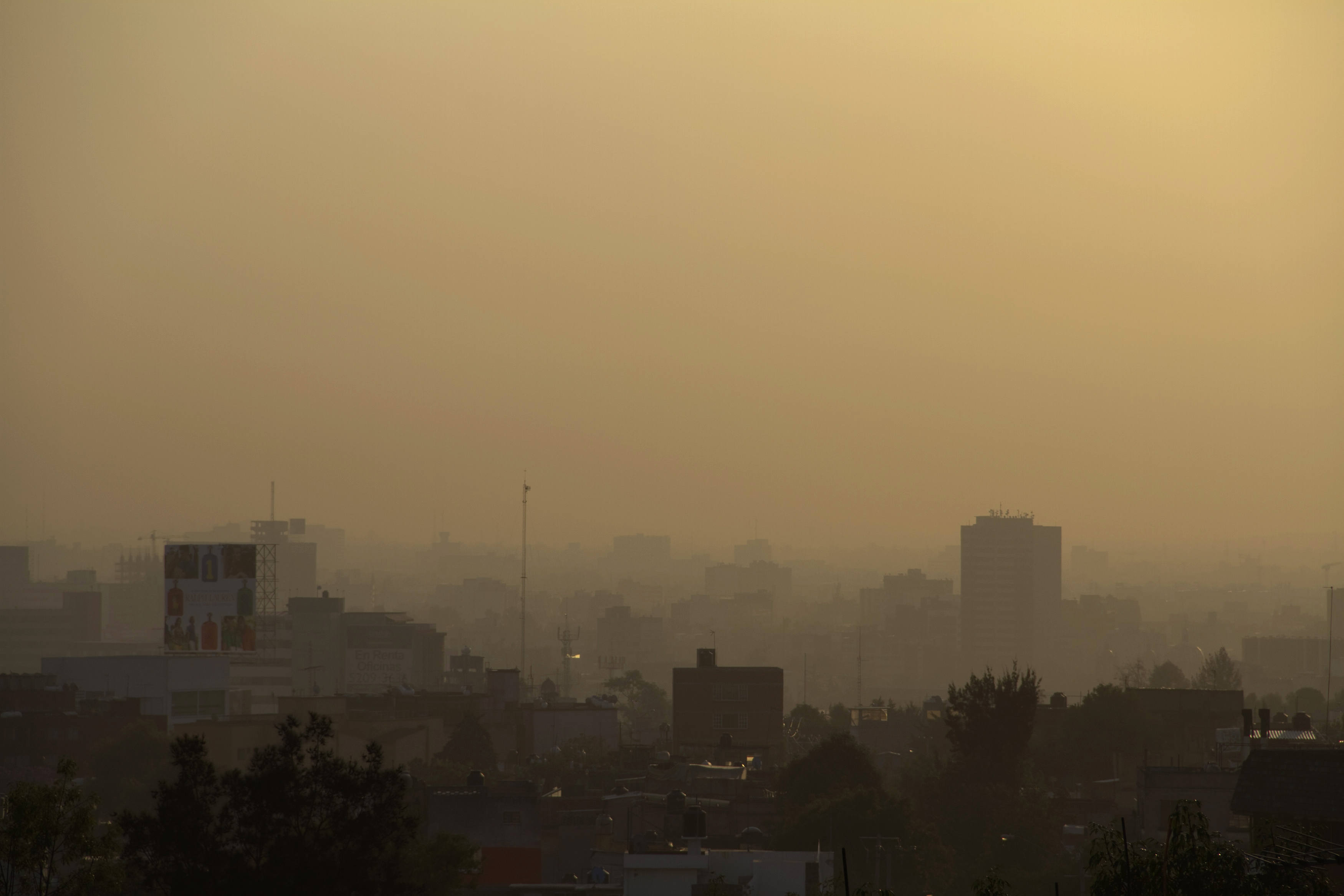Mexico City is seen through heavy smog in the early morning