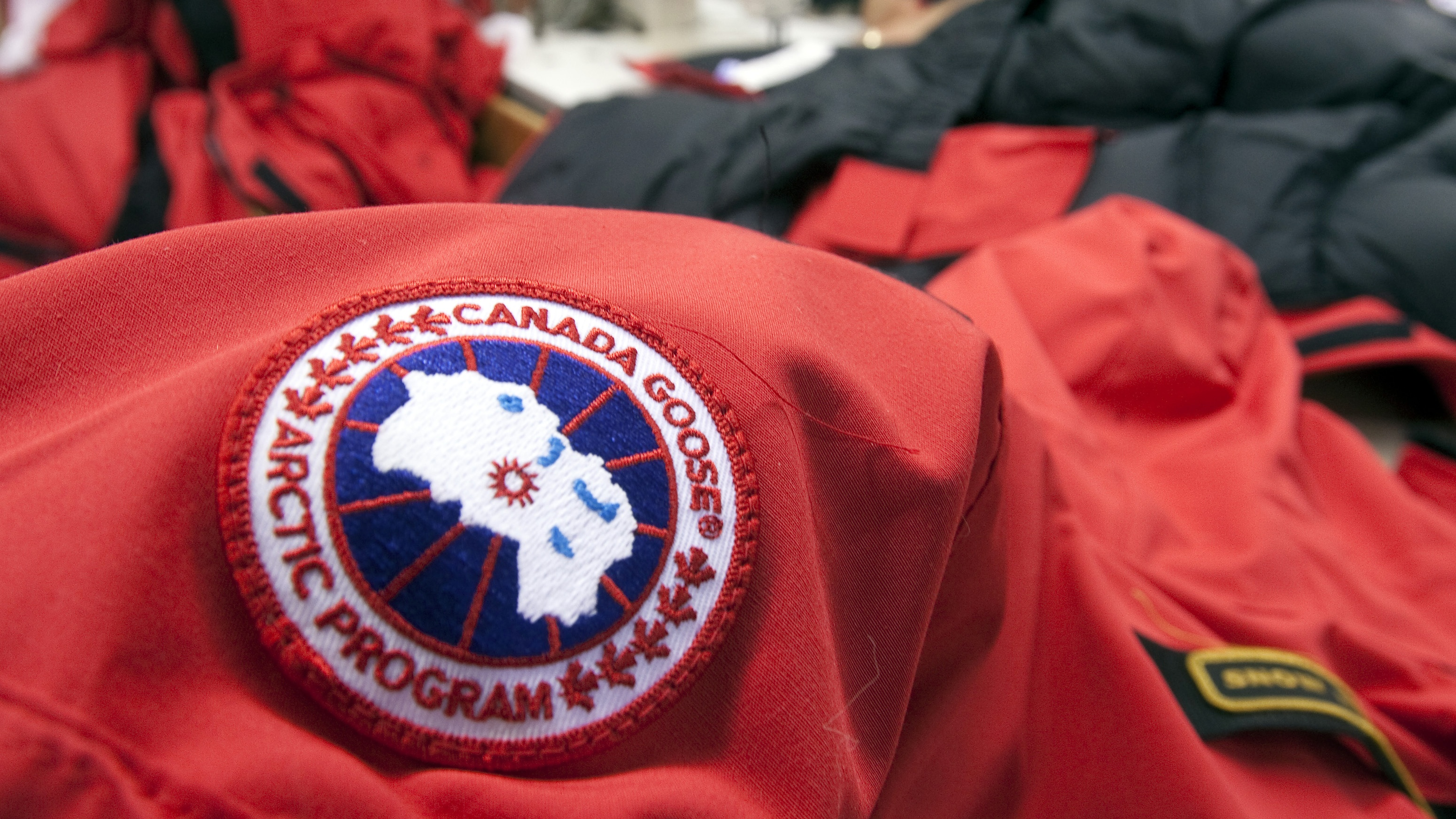 Workers piece together outerwear on the manufacturing floor of Canada Goose's facility in Toronto January 17, 2012. Coat maker Canada Goose found its niche by shunning the make-it-offshore phenomenon, producing its heavy duty down parkas on Canadian soil. Even as Canada's clothing industry crumbles, with employment down 60 percent in just over a decade, the 55-year old family-run shop bucked the broader trend of moving production to low-cost locales by keeping manufacturing at home. Picture taken January 17. To match Analysis CANADA-NICHE/ REUTERS/Fred Thornhill (CANADA - Tags: BUSINESS TEXTILE)