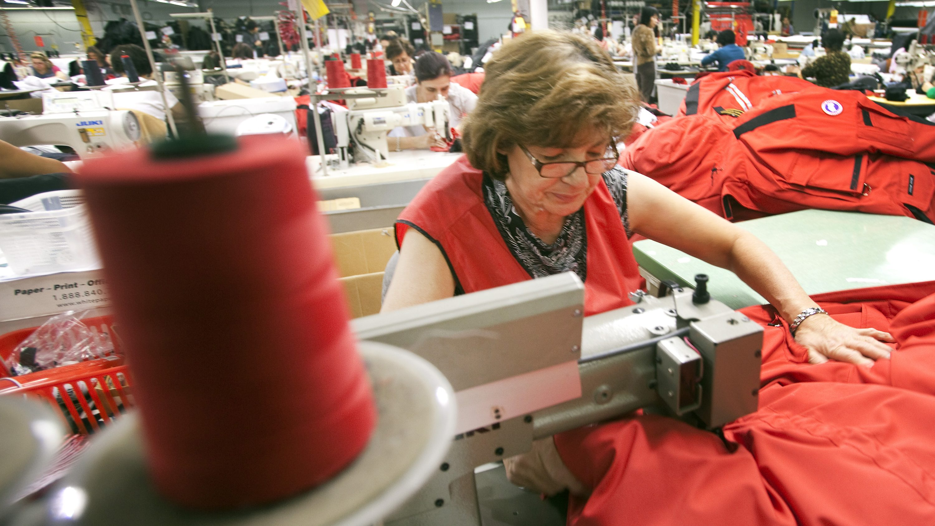 Paulina Botelho, a seamstress for Canada Goose, pieces together outerwear on the manufacturing floor of the company's facility in Toronto