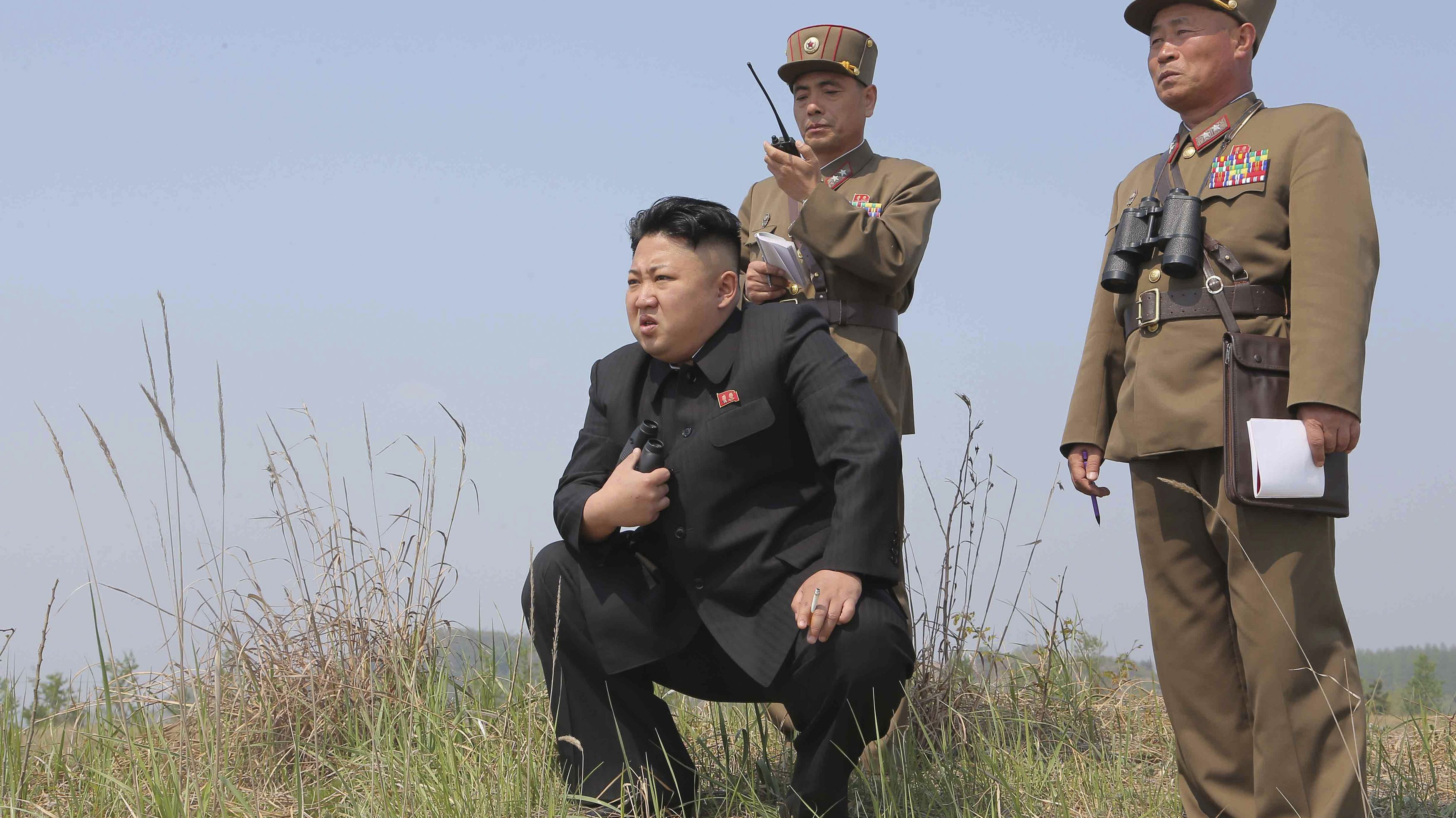 North Korean leader Kim Jong Un (C) guides the multiple-rocket launching drill of women's sub-units under KPA Unit 851, in this undated photo released by North Korea's Korean Central News Agency (KCNA) April 24, 2014.