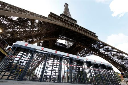 New control fences are seen at the bottom of the Eiffel Tower near the fan zone ahead of the UEFA 2016 European Championship in Paris, France, June 7, 2016.