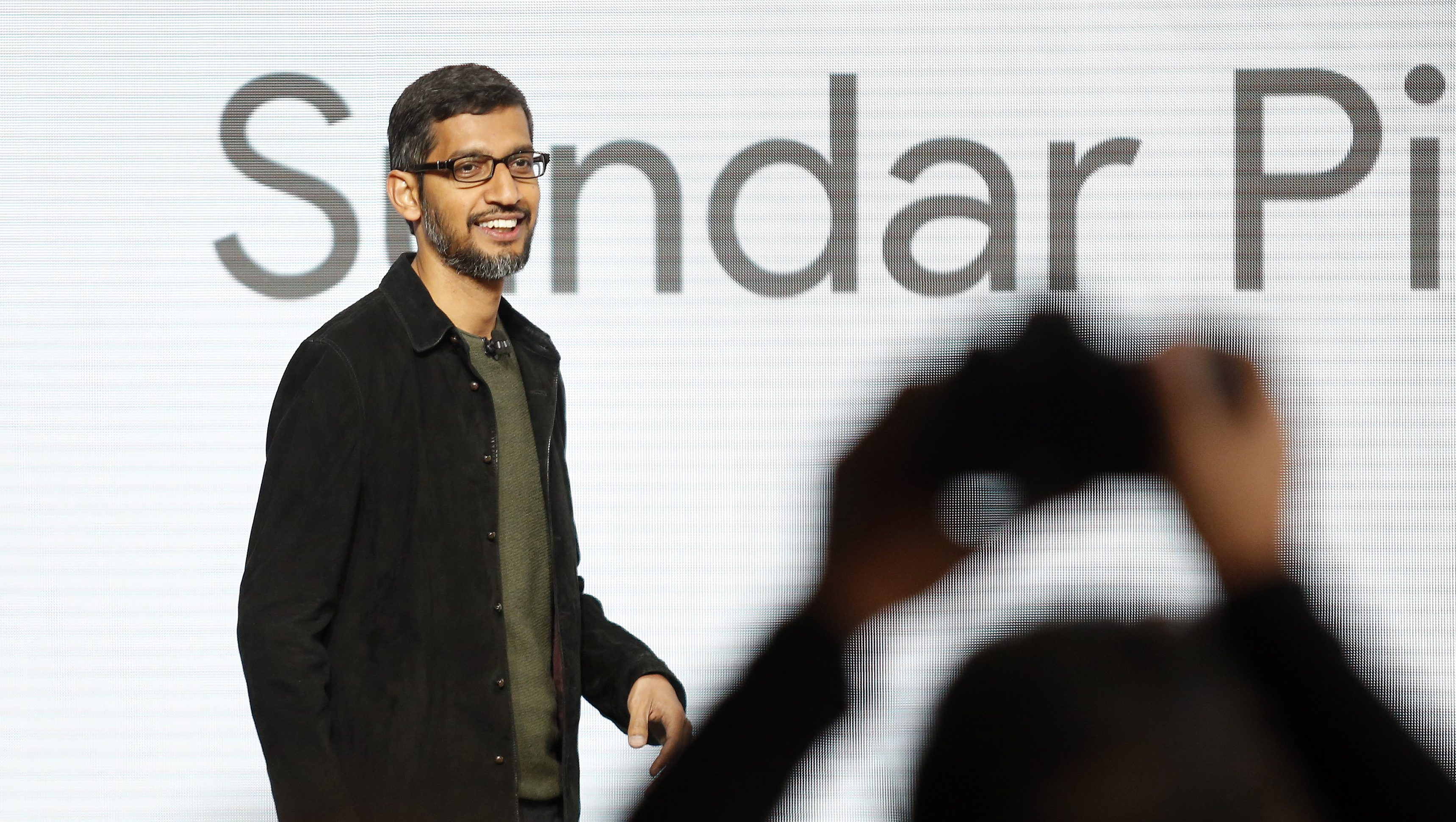 Google CEO Sundar Pichai takes the stage during the presentation of new Google hardware