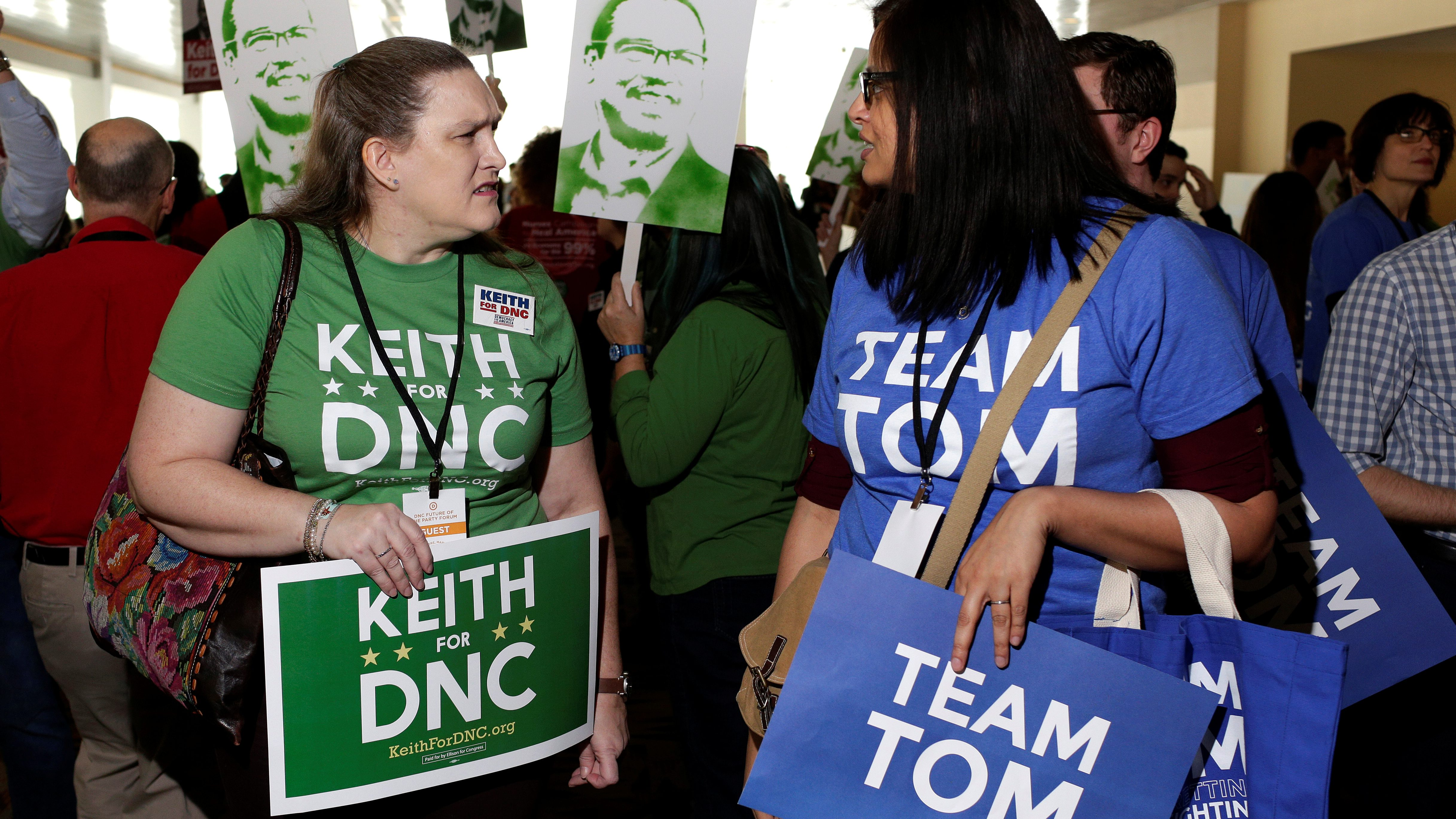 Supporters (L) of Rep. Keith Ellison (D-MN) and former Secretary of Labor Tom Perez, candidates for Democratic National Committee Chairman, speak to each other during a Democratic National Committee forum in Baltimore, Maryland, U.S. February 11, 2017.       - RTSY6ON