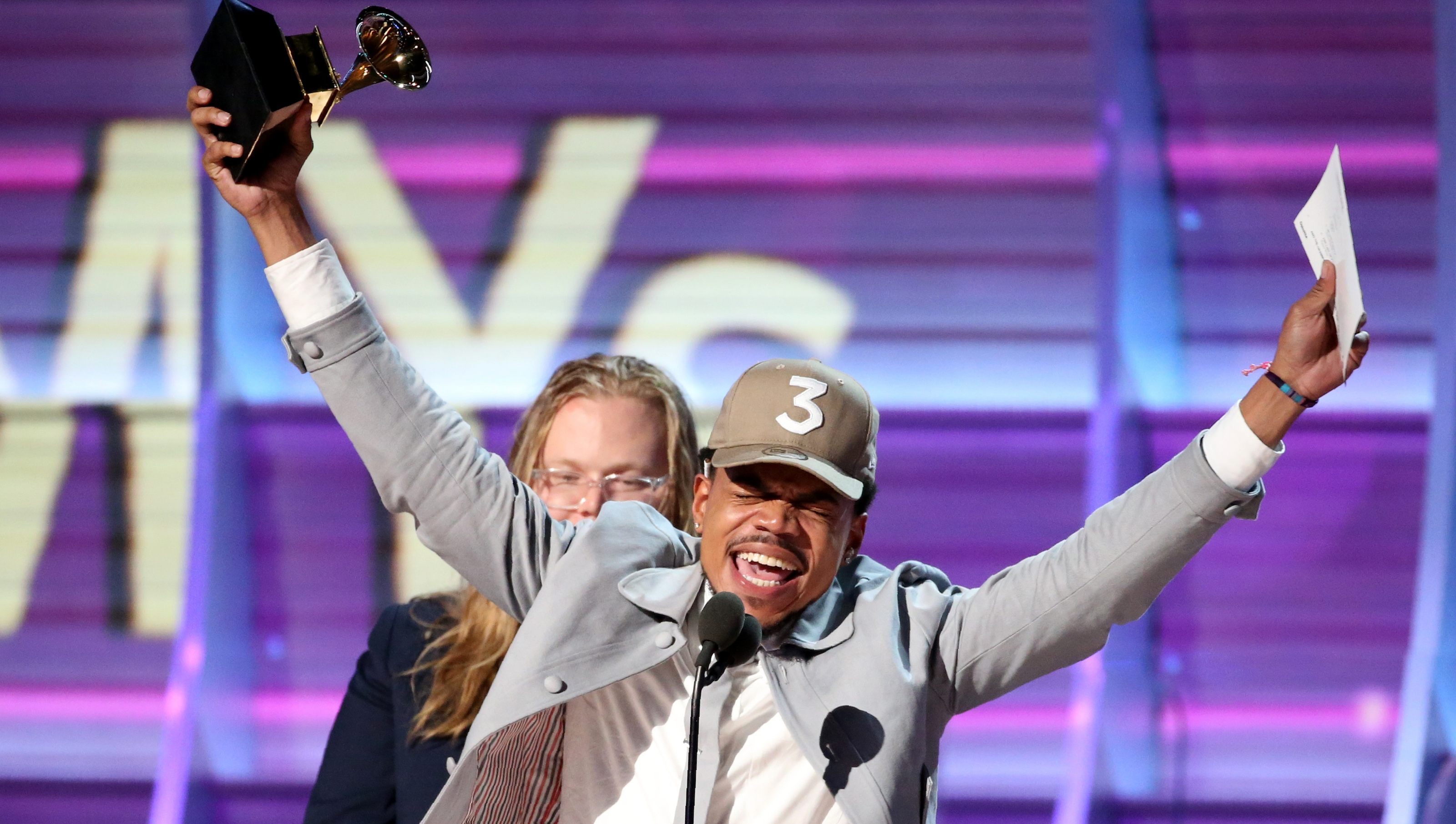 "Chance the Rapper celebrates as he accepts the Grammy for Best Rap Album for ""Coloring Book"" at the 59th Annual Grammy Awards in Los Angeles, California, U.S. , February 12, 2017. REUTERS/Lucy Nicholson - RTSYCSU"