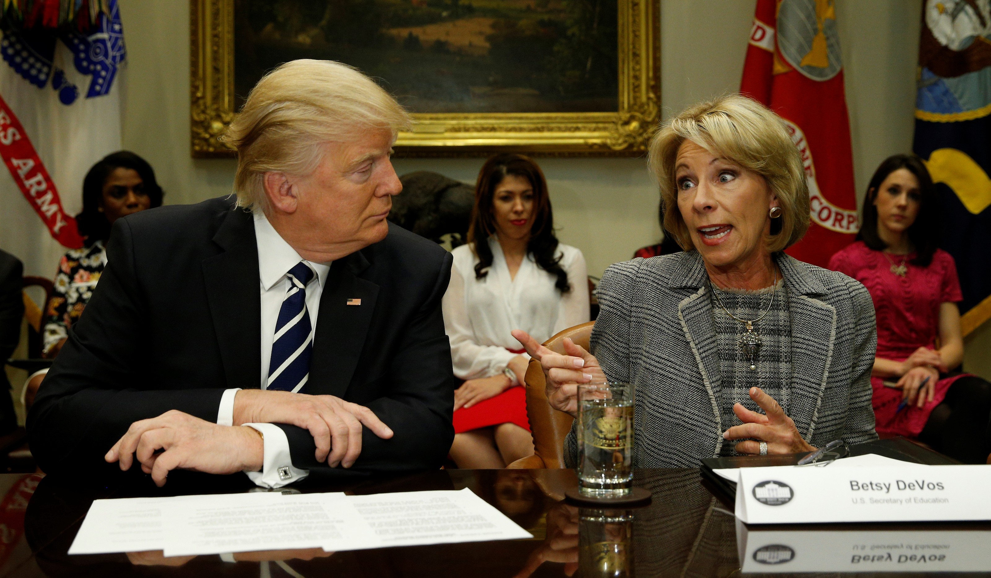 U.S. President Donald Trump listens to U.S. Secretary of Education Betsy DeVos speak at meeting with teachers and parents at the White House in Washington, U.S., February 14, 2017.  REUTERS/Kevin Lamarque - RTSYN1X