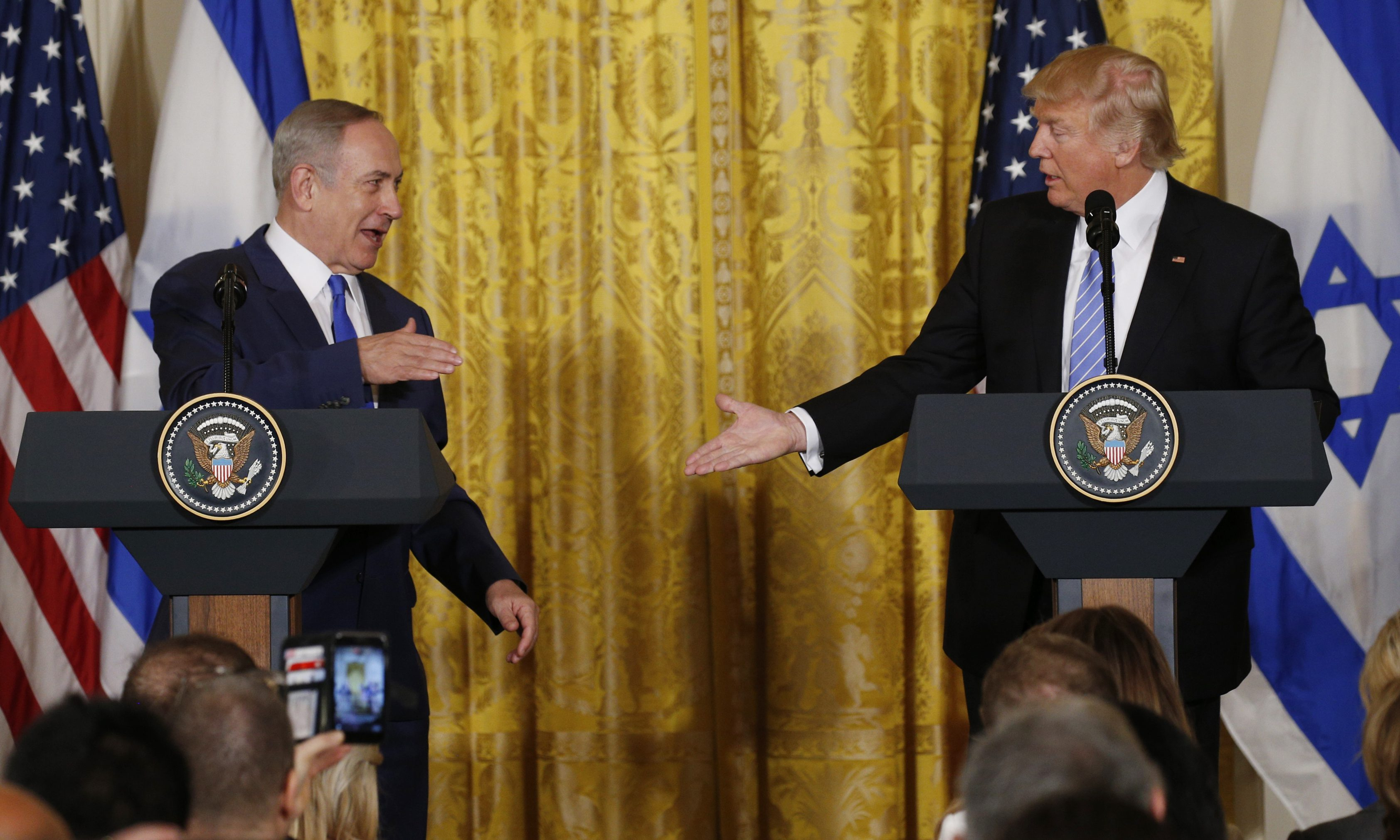 U.S. President Donald Trump (R) greets Israeli Prime Minister Benjamin Netanyahu after a joint news conference at the White House in Washington, U.S., February 15, 2017.   REUTERS/Kevin Lamarque  - RTSYU8U