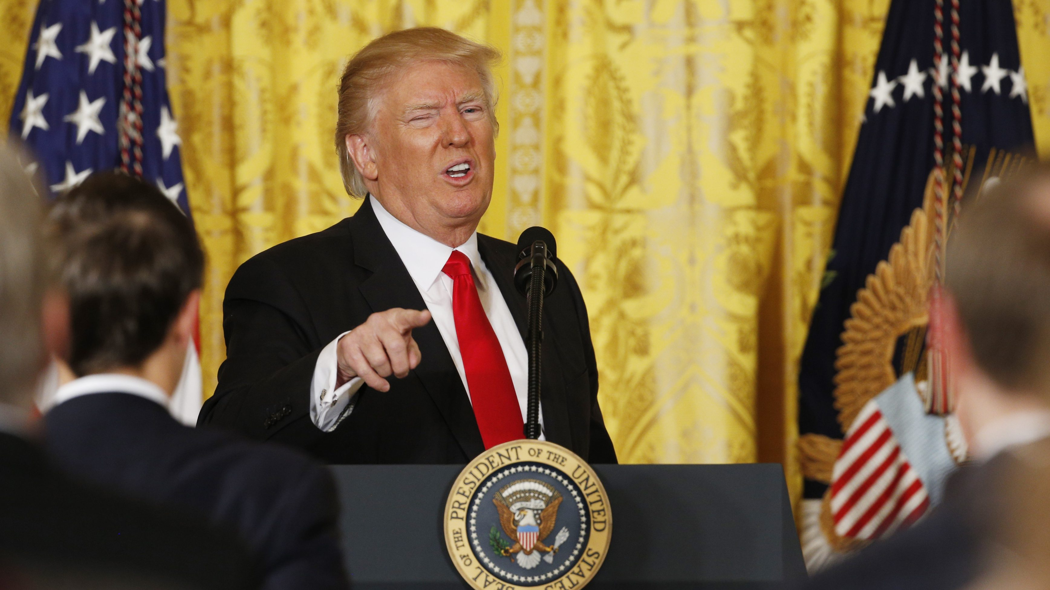 U.S. President Donald Trump gestures as he leaves the podium after a news conference at the White House in Washington, U.S., February 16, 2017.  REUTERS/Kevin Lamarque   - RTSZ1DB